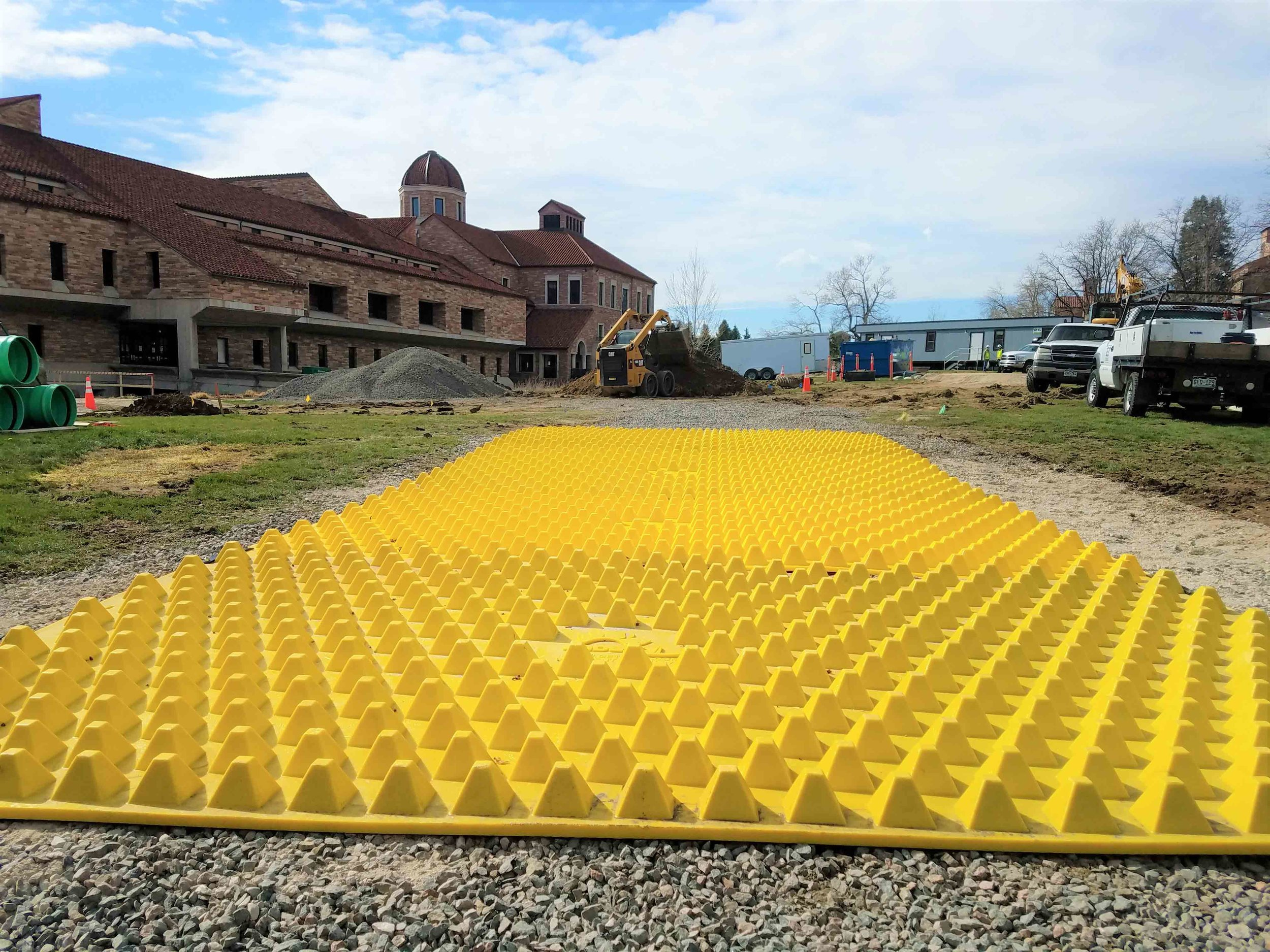 FODS_CUEngineeringBusiness_expansionProjects_FODSTrackoutControlSystem_ConstructionEntranceConstructionExit_mudMats_yellowPlasticConstructionMats_wheelwash_rumbleGrate.jpg