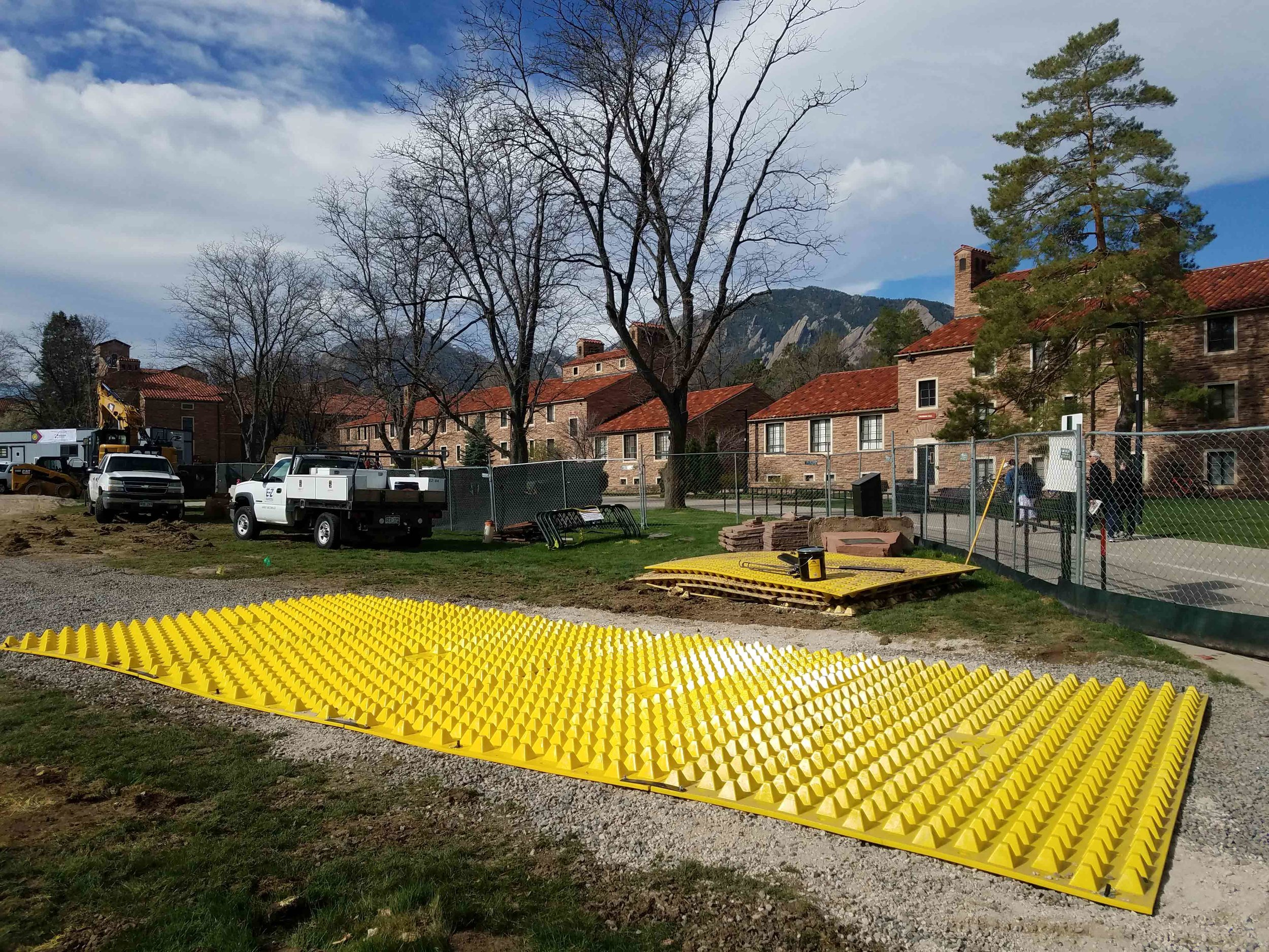 FODS_CUEngineeringBusiness_expansionProjects_FODSTrackoutControlSystem_ConstructionEntranceConstructionExit_mudMats_yellowPlasticConstructionMats_wheelwash_rumbleGrate_geotextileConstructionEntrance.jpg