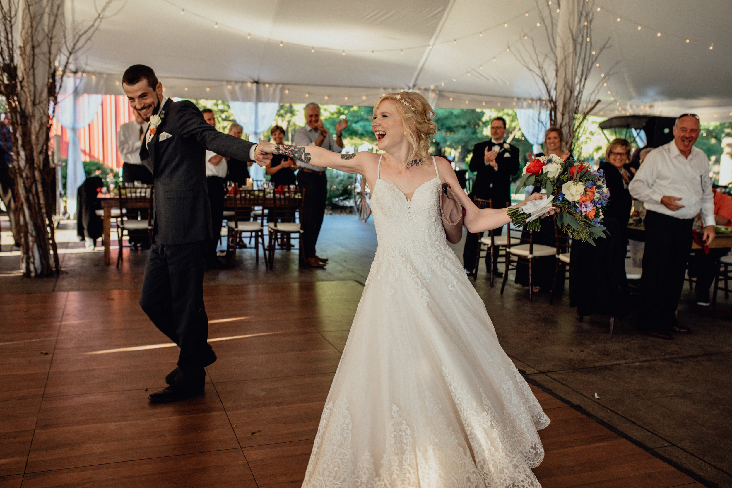 bride and groom entering reception at oak hill weddings