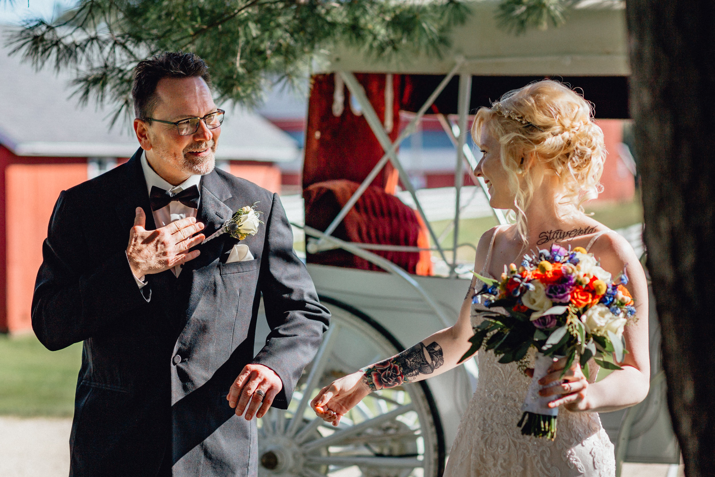 Bride arriving to ceremony in horse drawn carriage with father at oak hill weddings