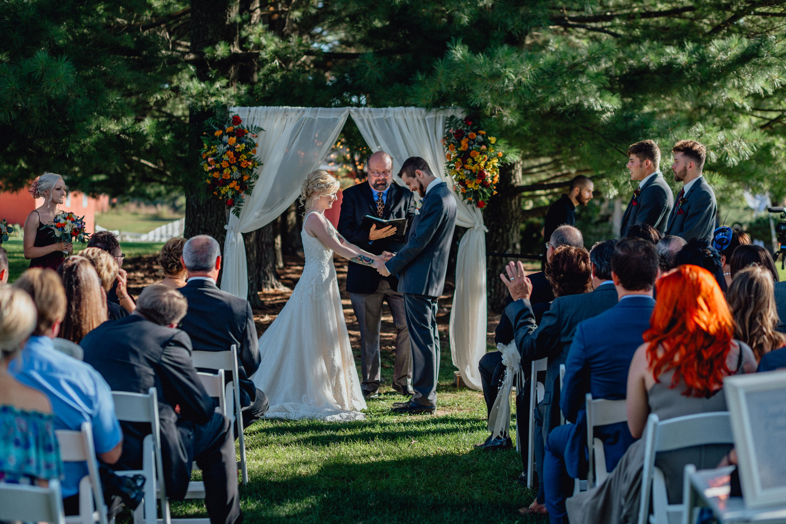 Bride and groom at ceremony at oak hill weddings