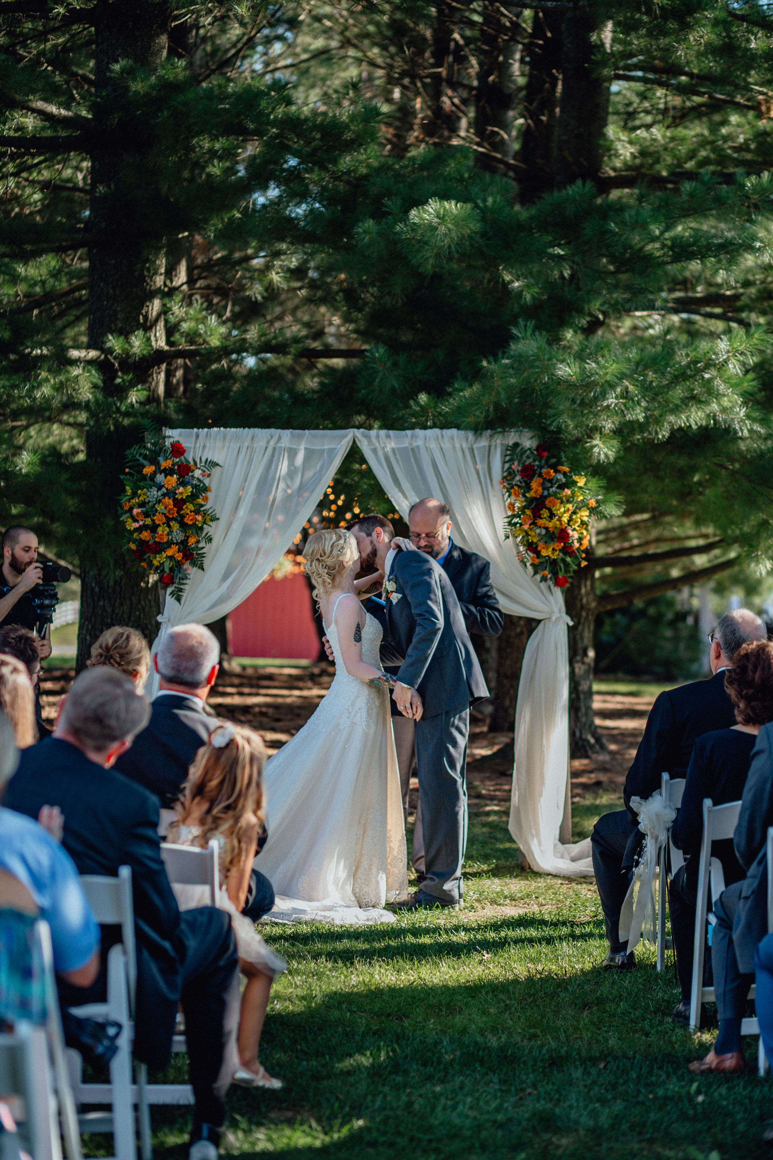 Bride and groom first kiss at ceremony at oak hill weddings
