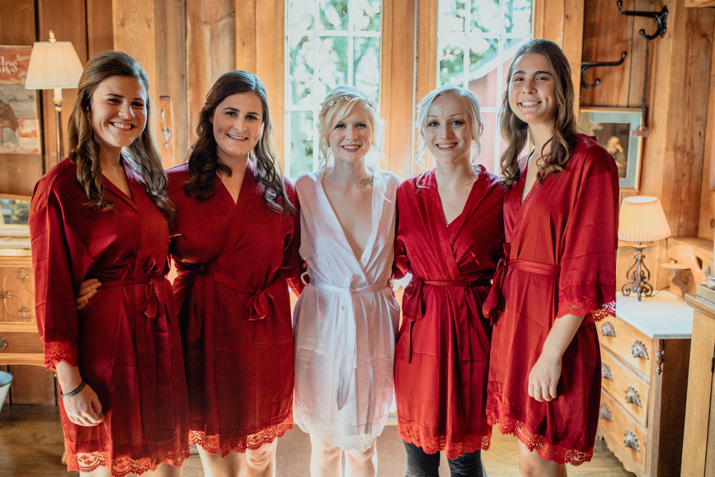 Bridesmaids and bride in robes getting posing