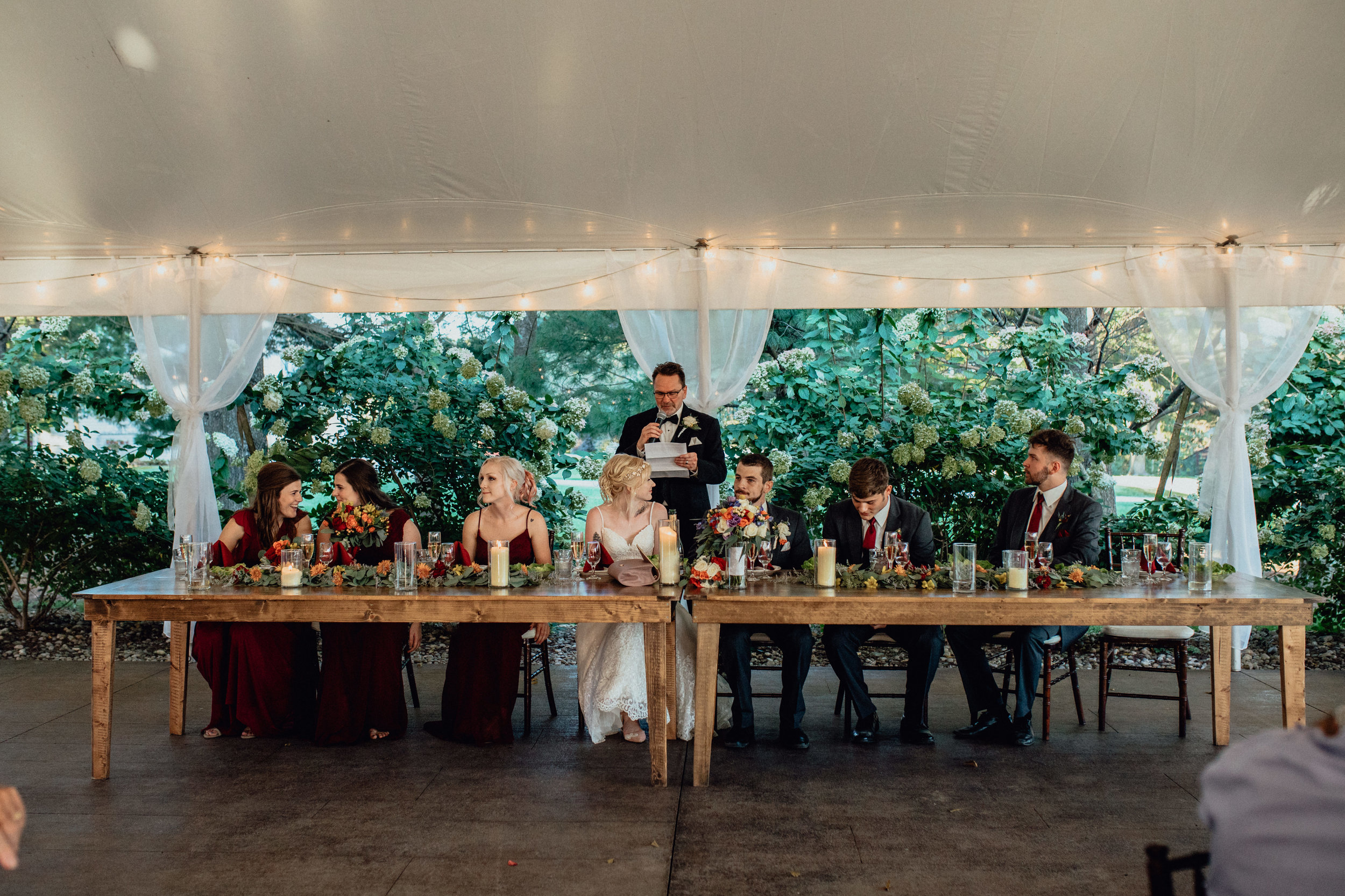 head table under tent at oak hill weddings