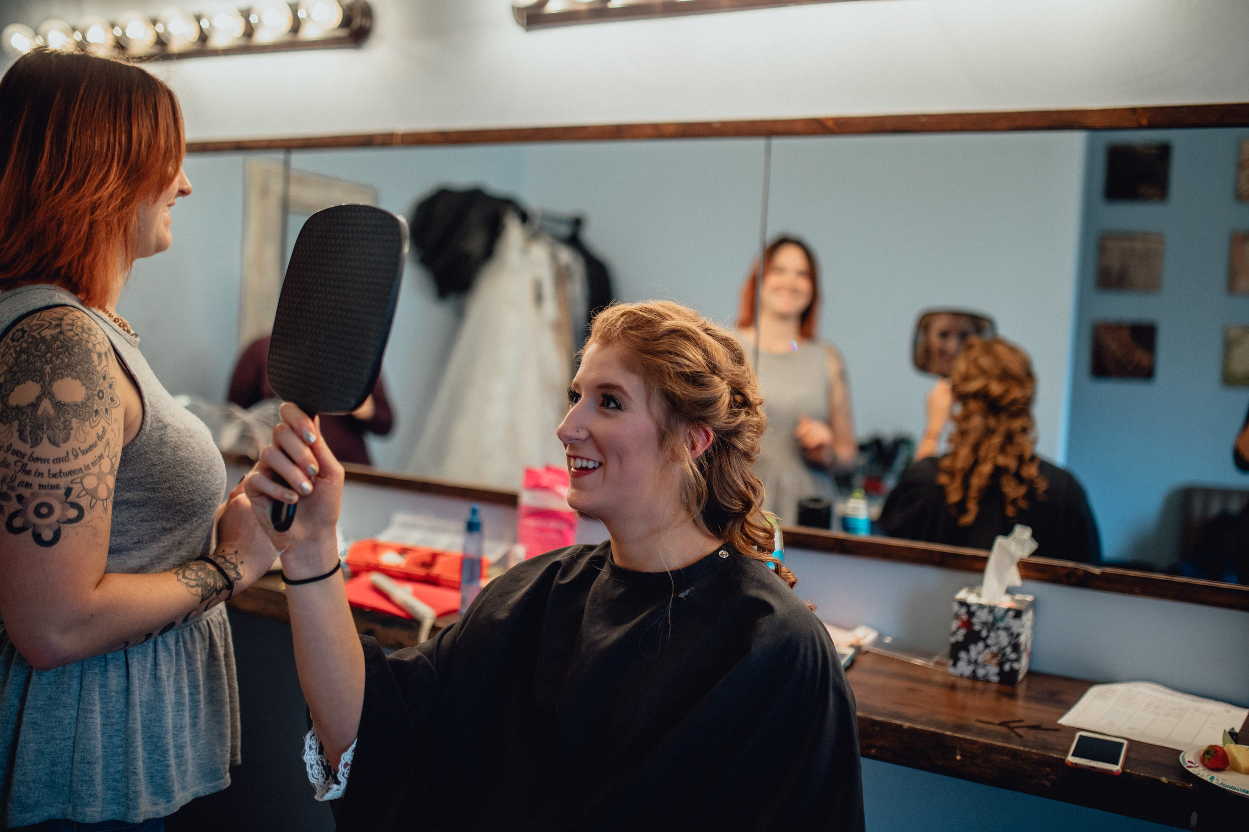 bride-looking-at-hair-in-mirror-bride-getting-hair-done-at-RUSTIC-MANOR-1848.jpg