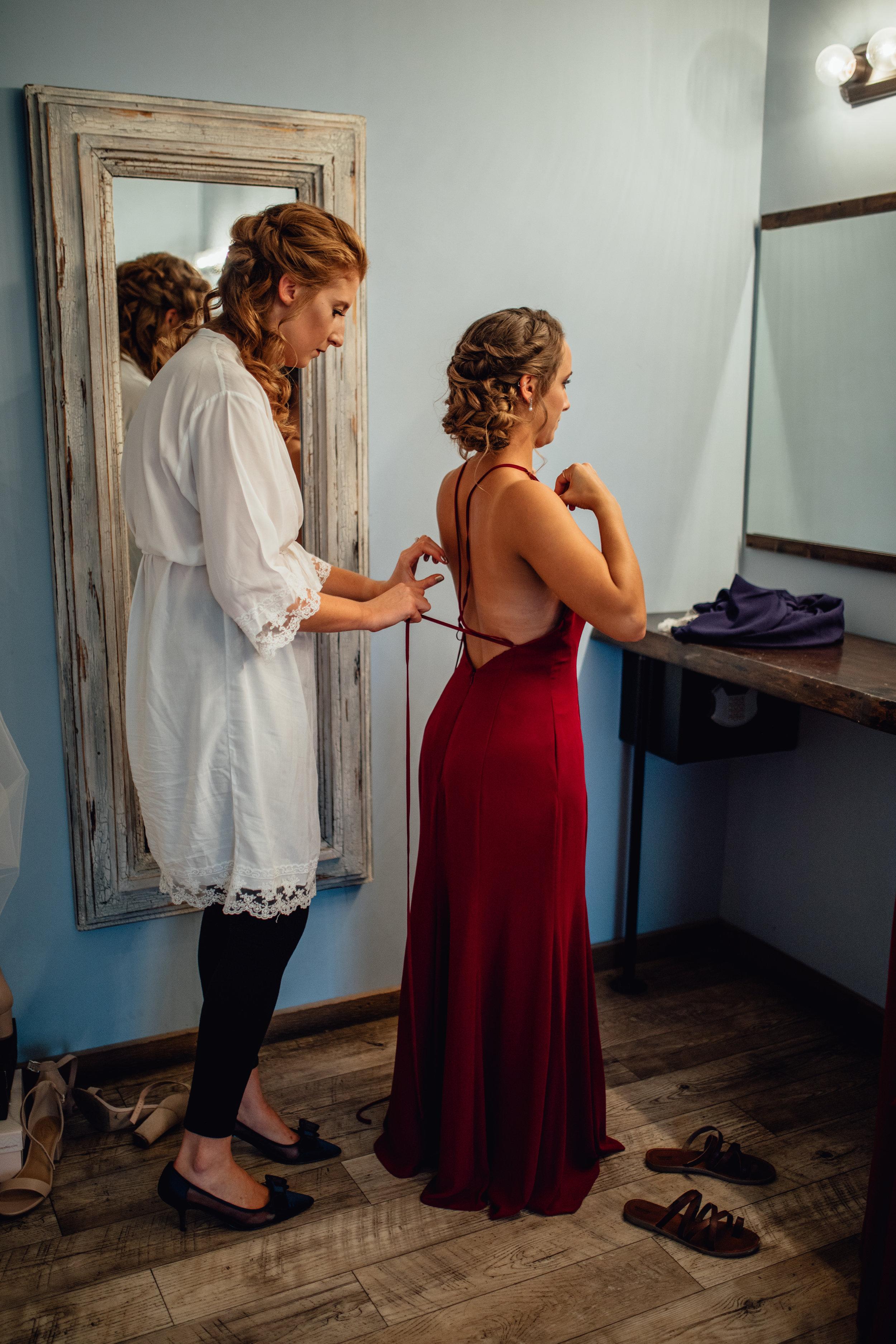 bride-tying-back-of-bridesmaids-dress.jpg