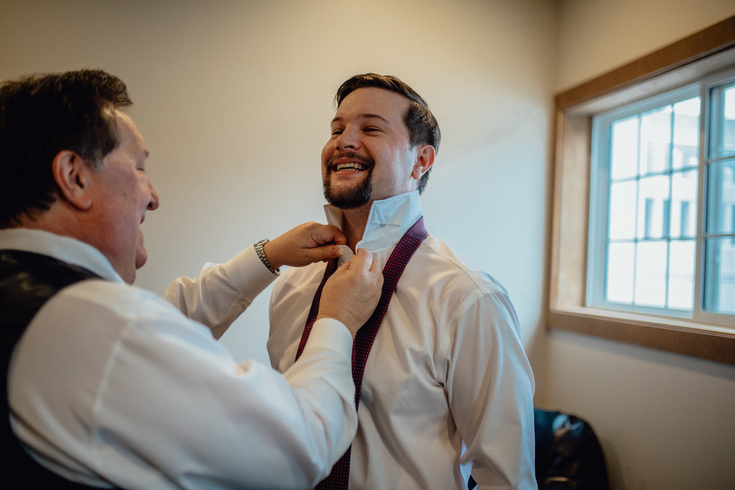 groom-putting-on-tie.jpg