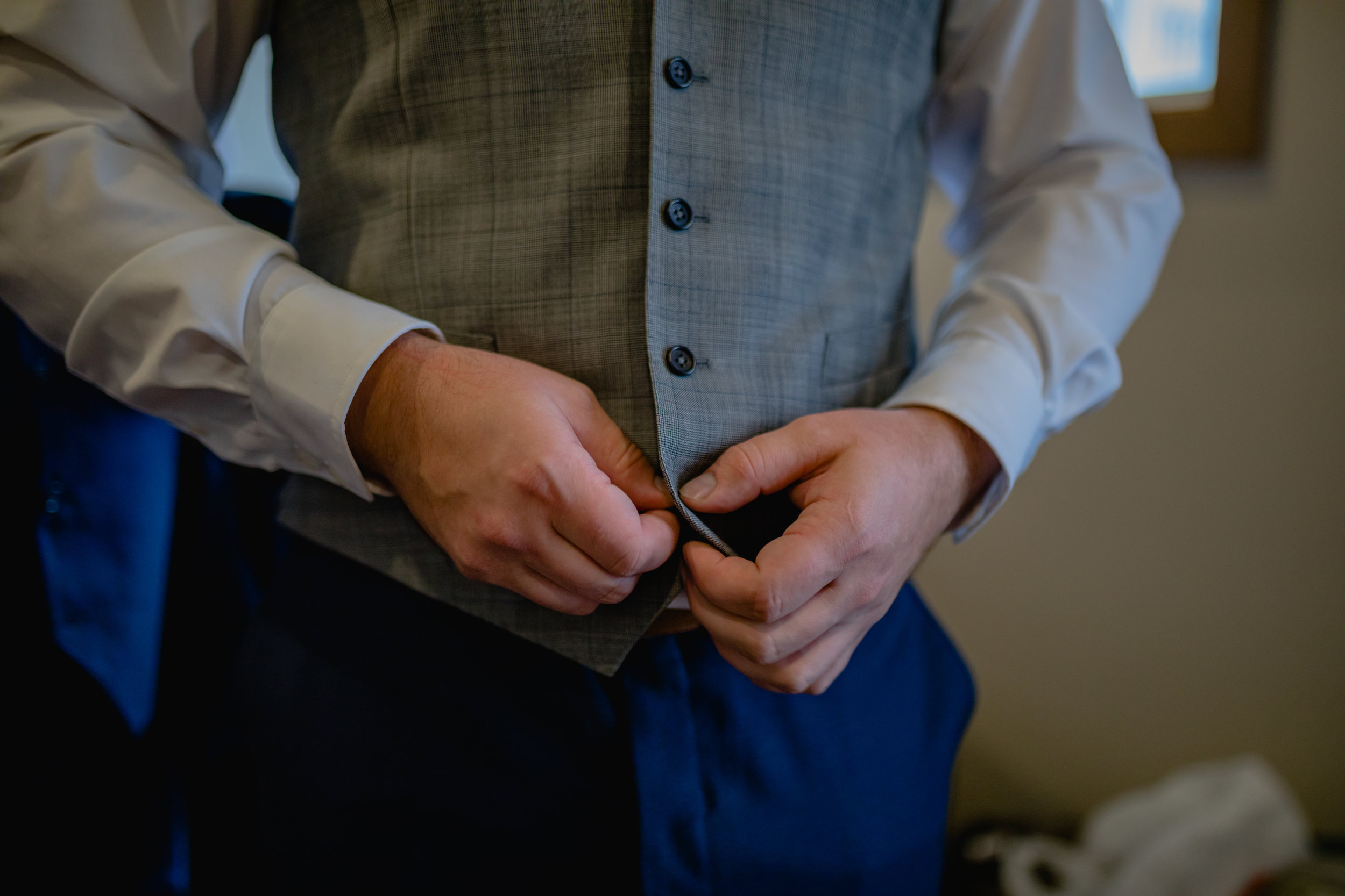 groom-buttoning-vest.jpg