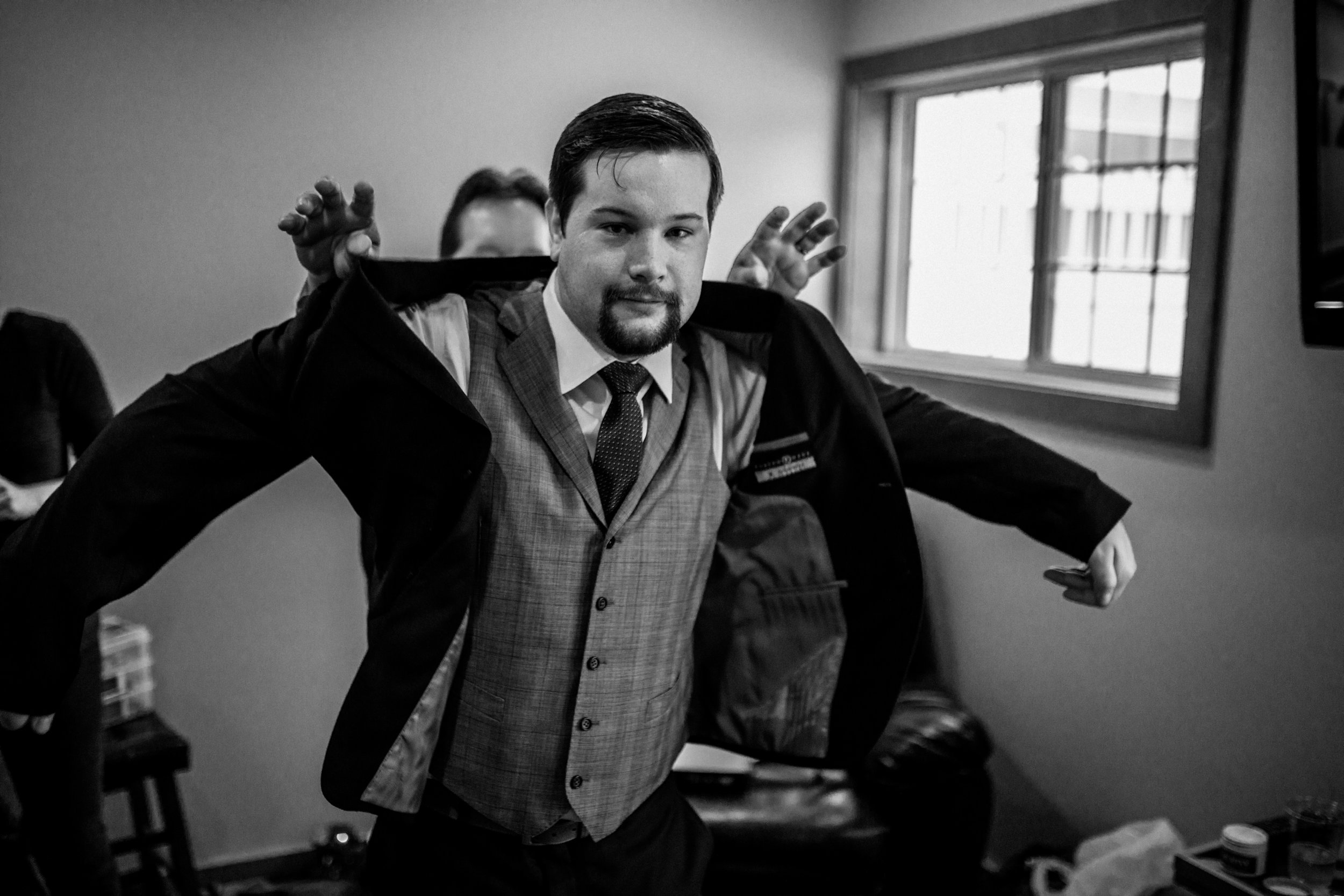 groom-getting-on-jacket.jpg
