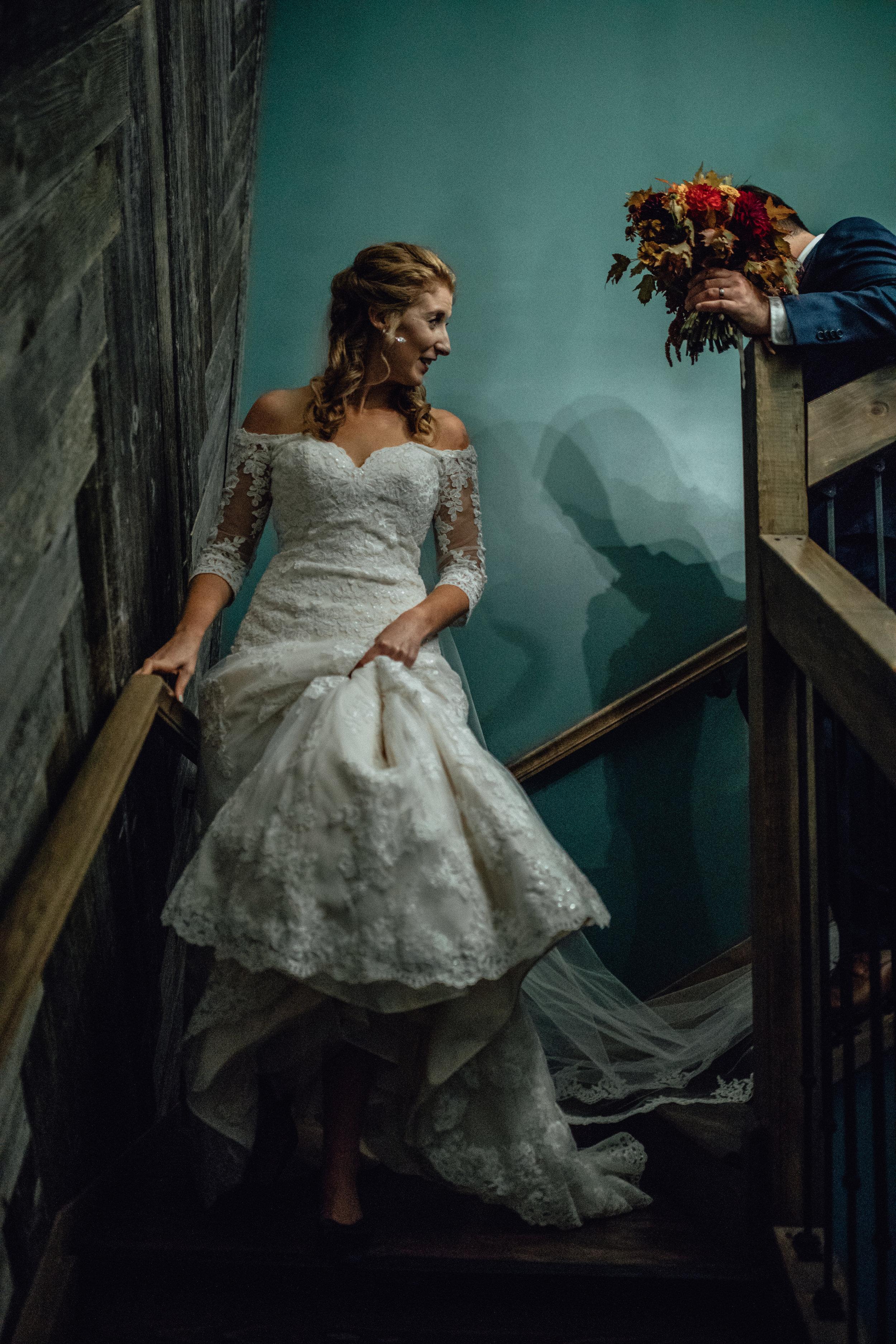 bride-and-groom-walking-down-stairs-at-rustic-manor-1848.jpg