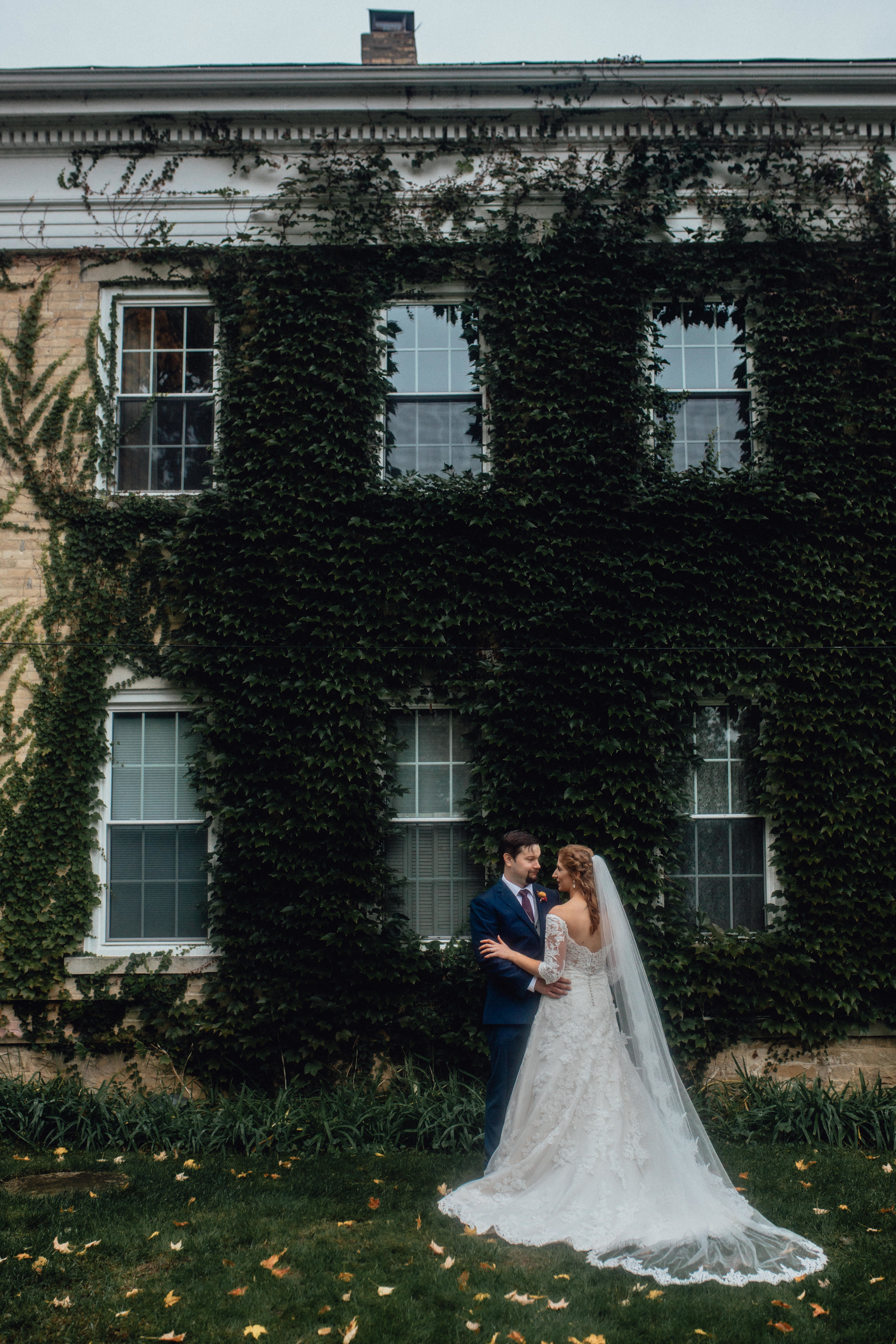 bride-and-groom-portrait-at-rustic-manor-1848-with-ivy.jpg