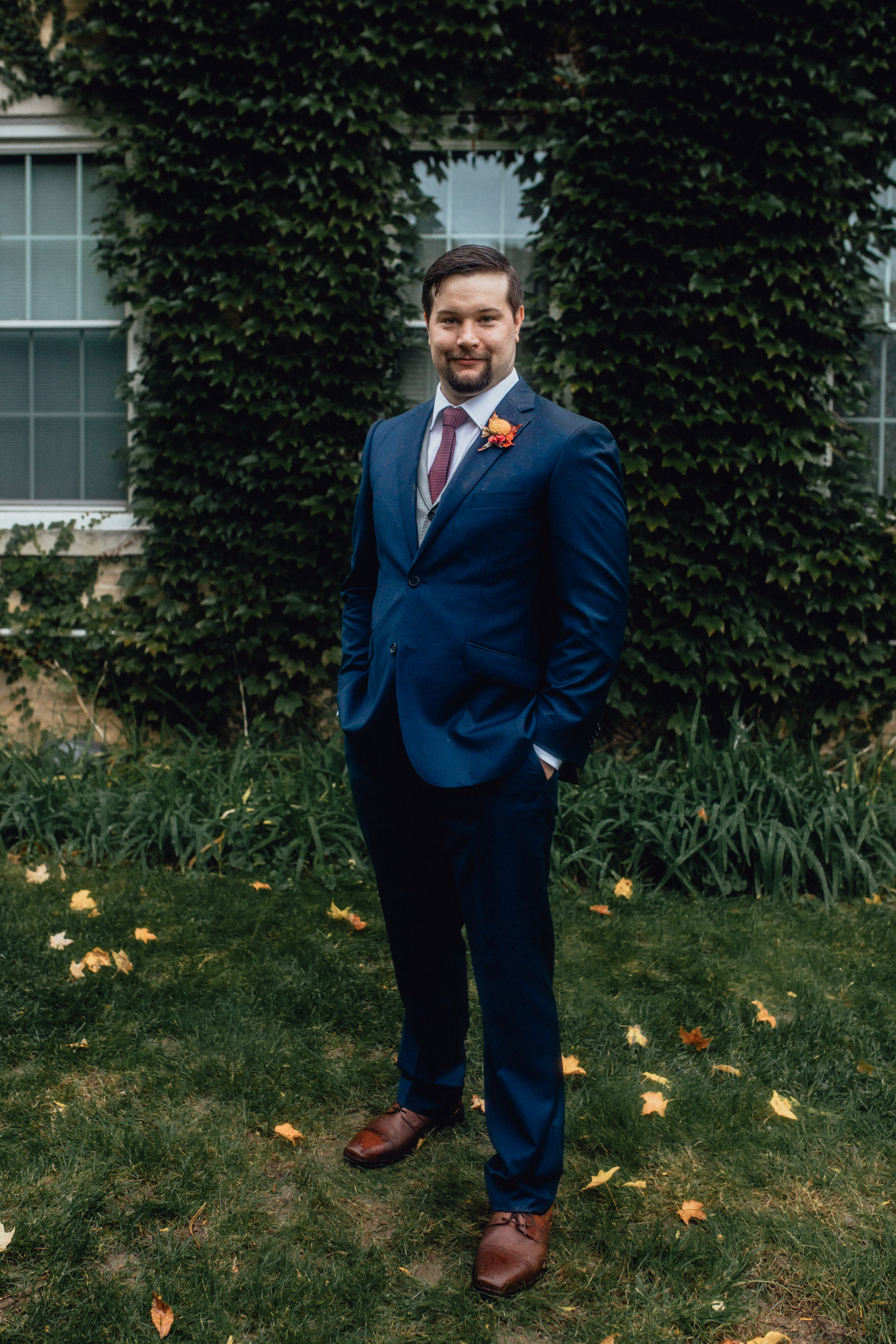 groom-portrait-at-rustic-manor-1848-with-ivy.jpg