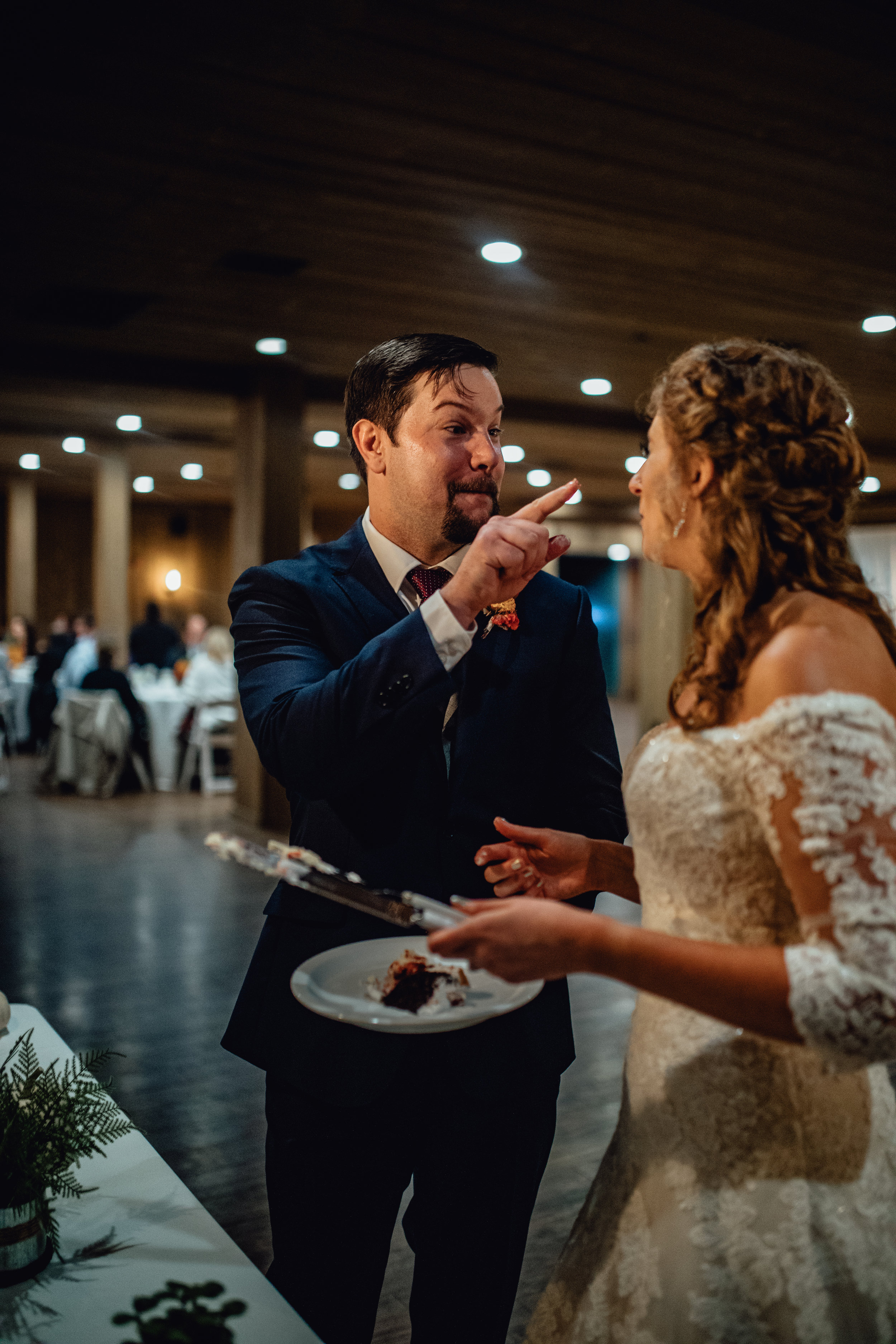 bride-and-groom-cutting-cake-at-rustic-manor-1848.jpg