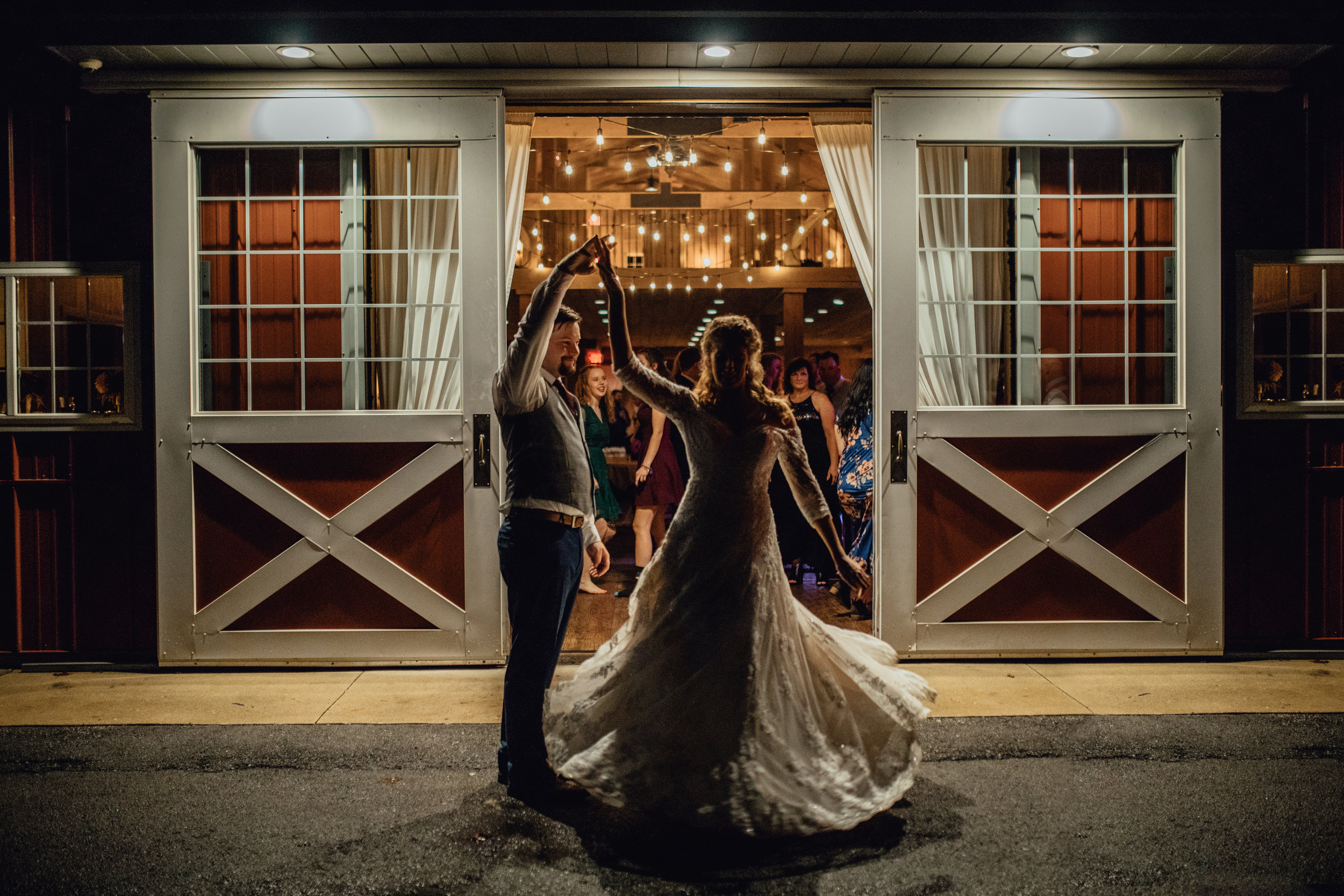 bride-and-groom-dancing-outside-barn-at-night-rustic-manor-1848.jpg