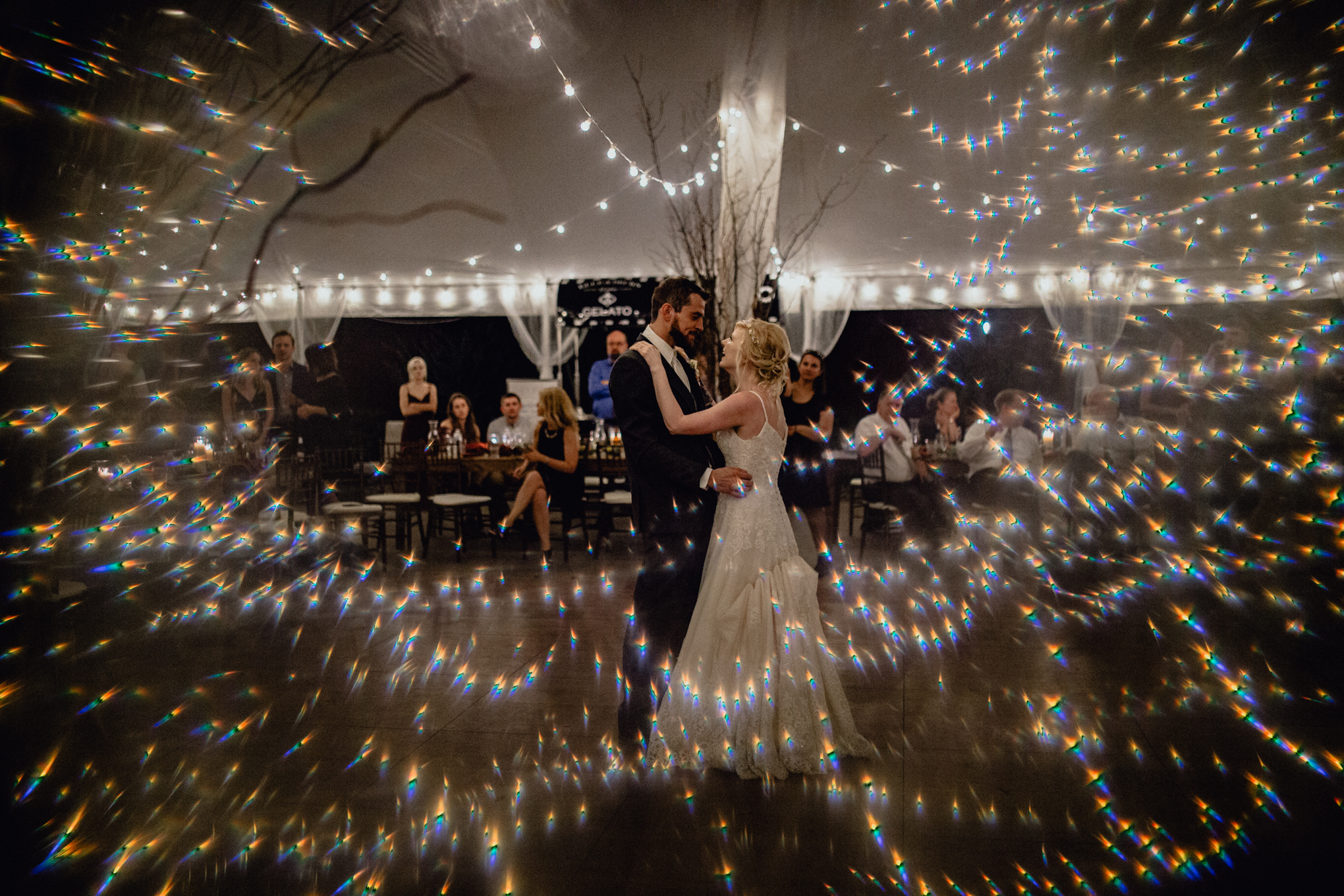 bride and groom share first dance with crystal at reception at oak hill weddings