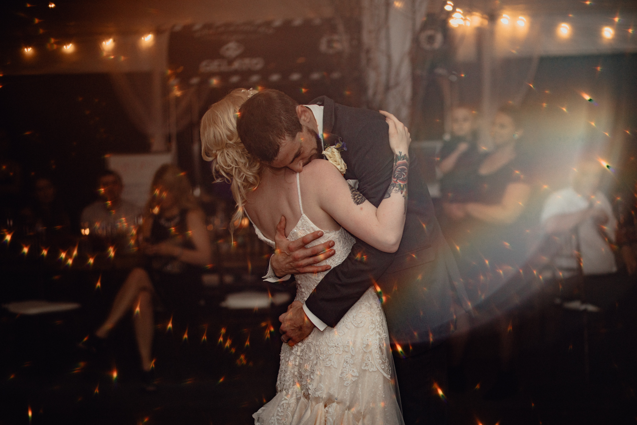 bride and groom share first dance at reception at oak hill weddings rainbow flare