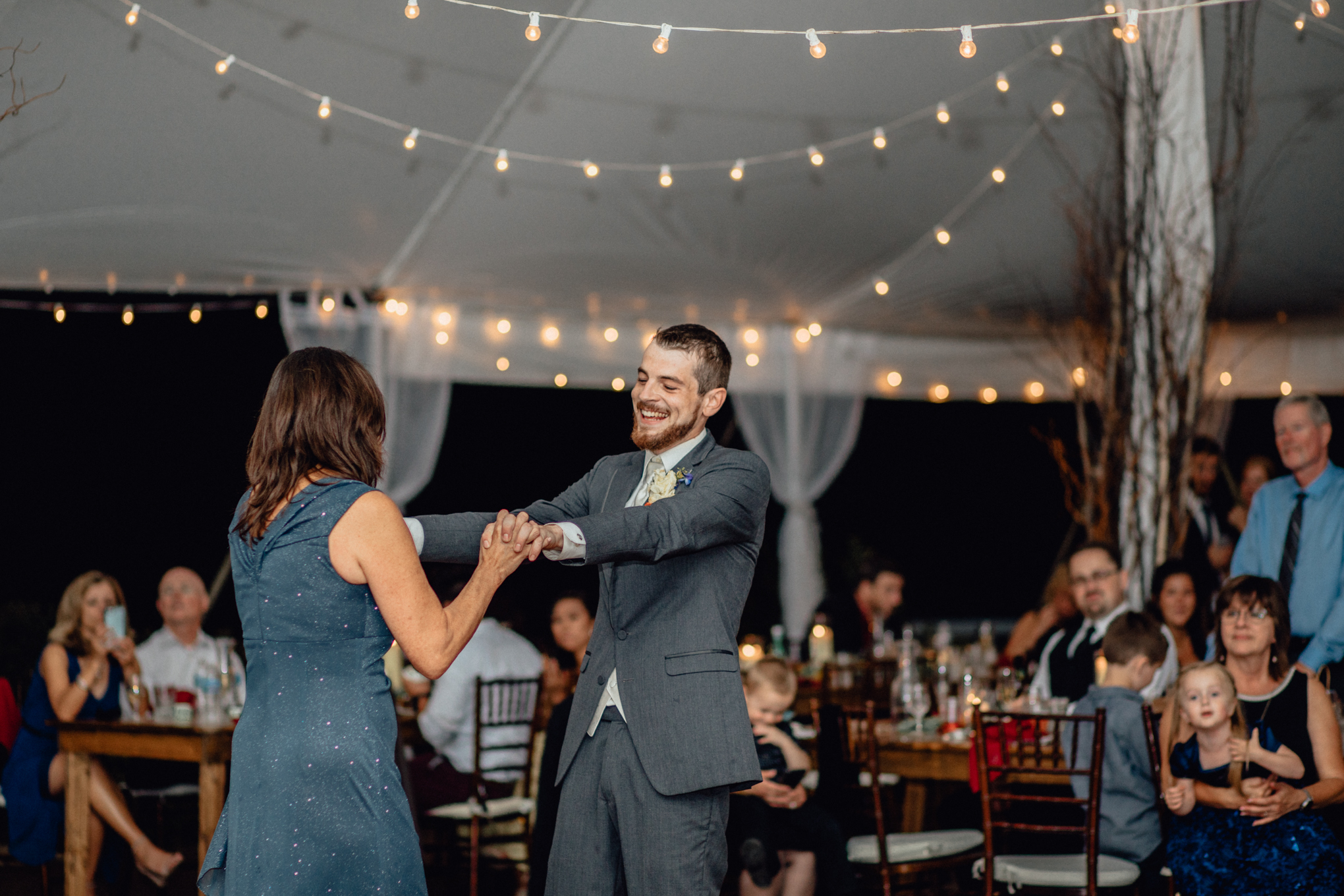 mother son groom dance at reception at oak hill weddings