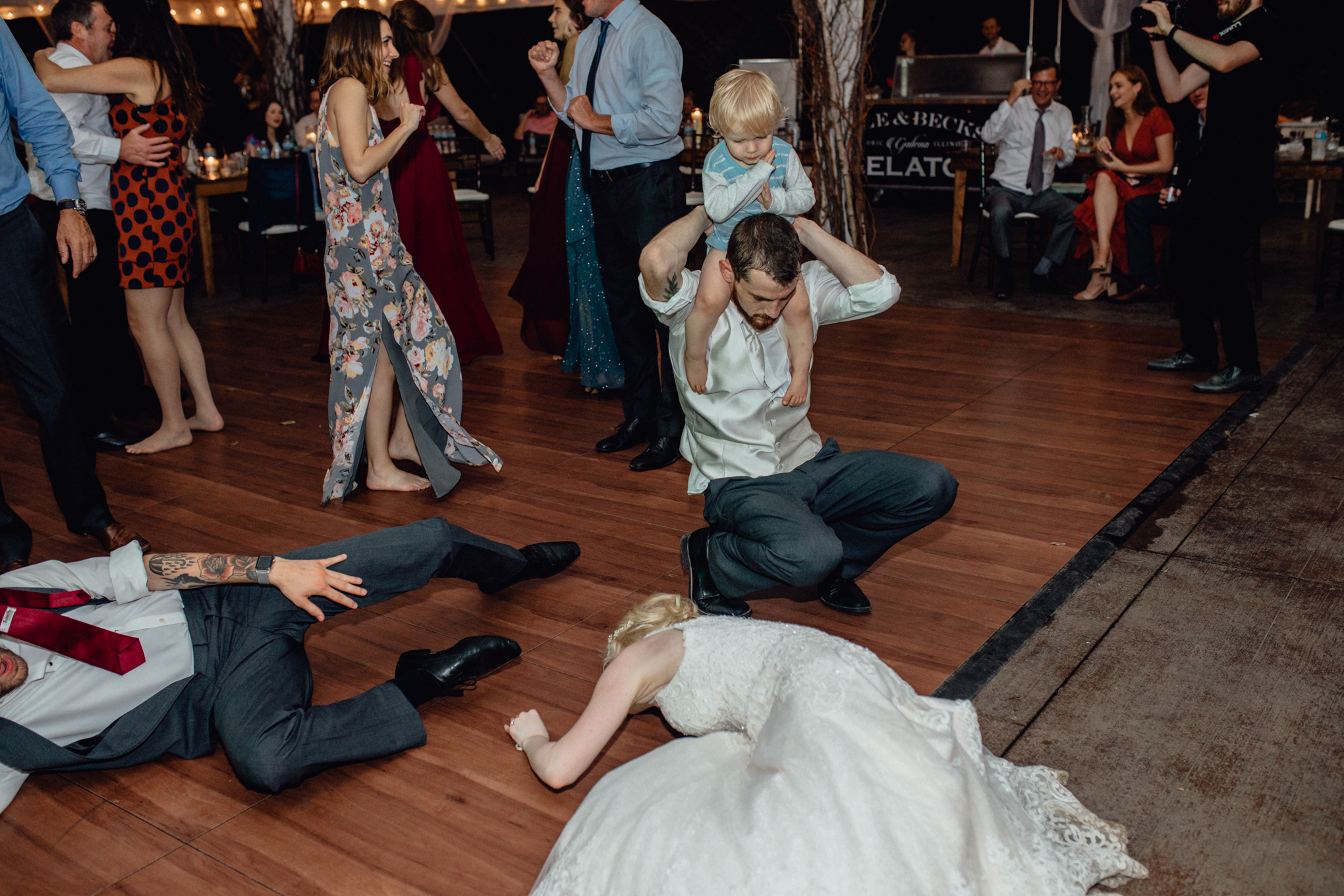 bride and groom dancing on floor under tent reception at oak hill weddings