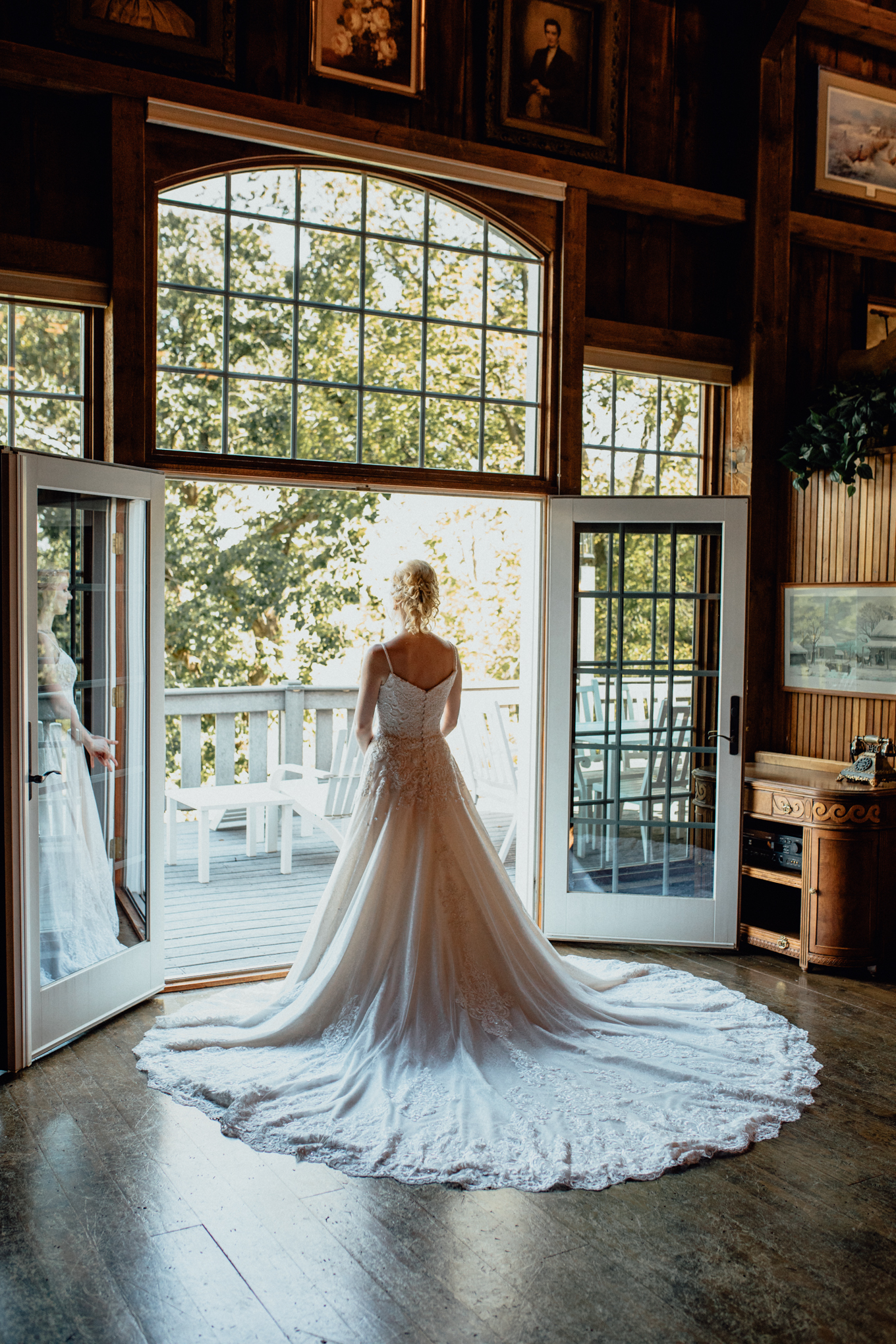 Bride looking out to pond from barn at oak hill weddings