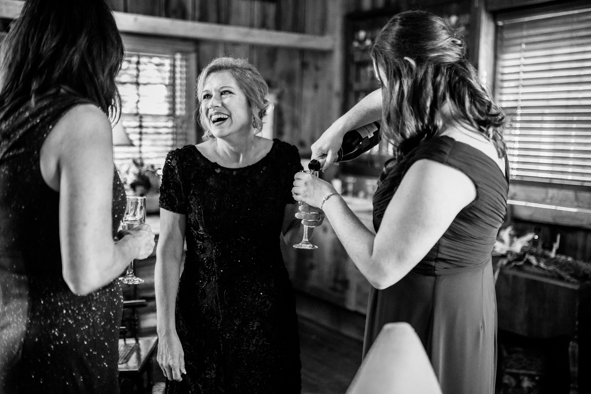 Mother of bride with glass of champagne before ceremony