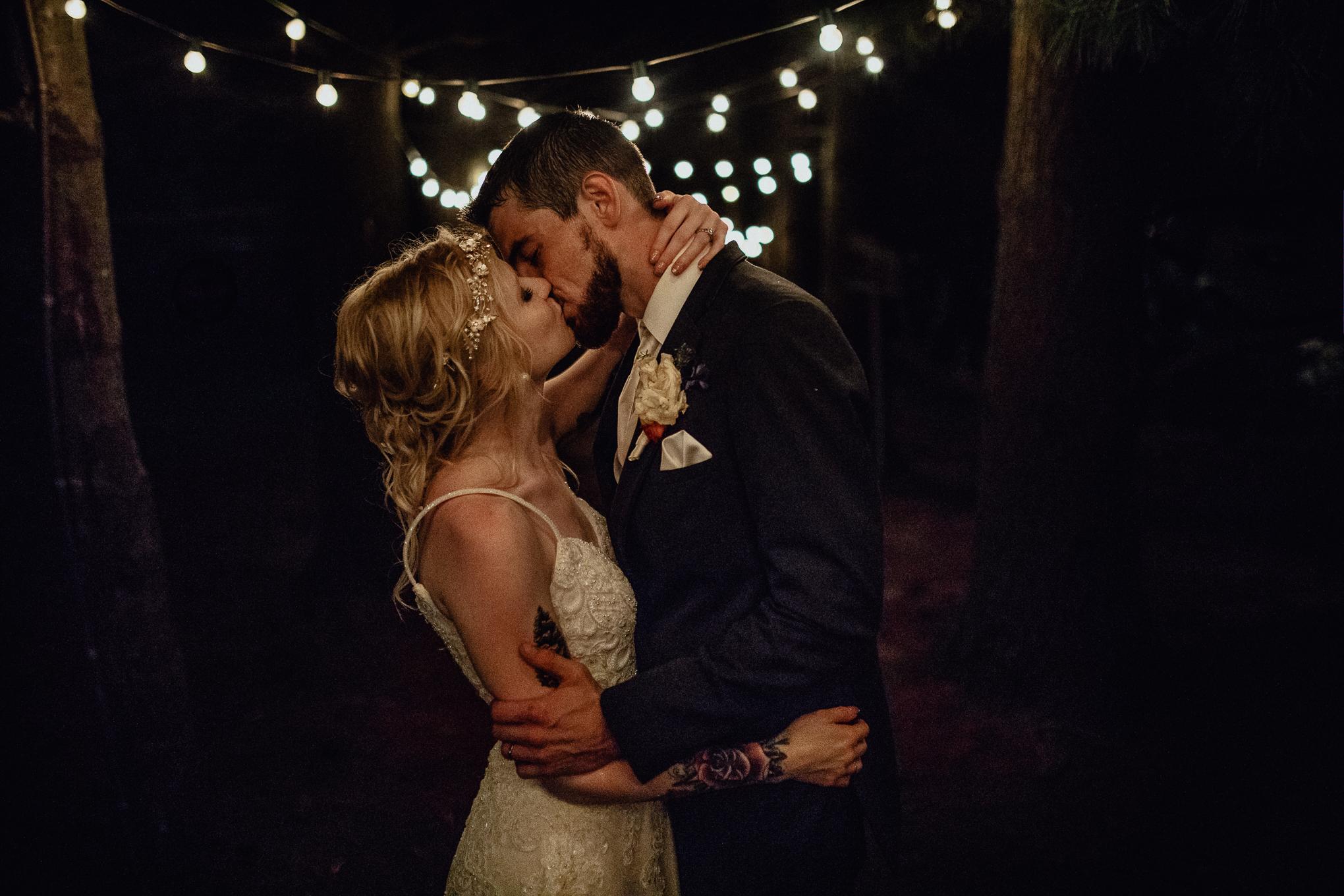 wedding-couple-kissing-under-string-lights.jpg