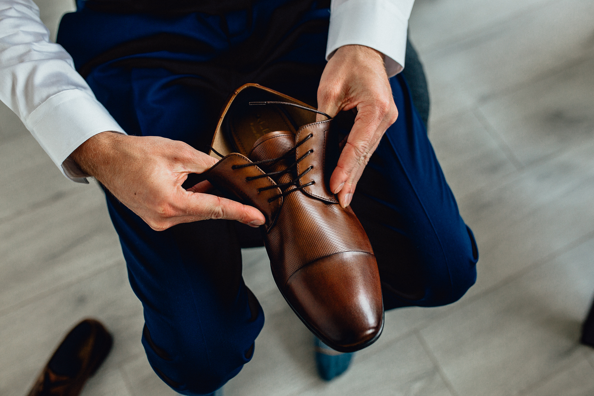 Groom-getting-ready-putting-on-shoes.jpg