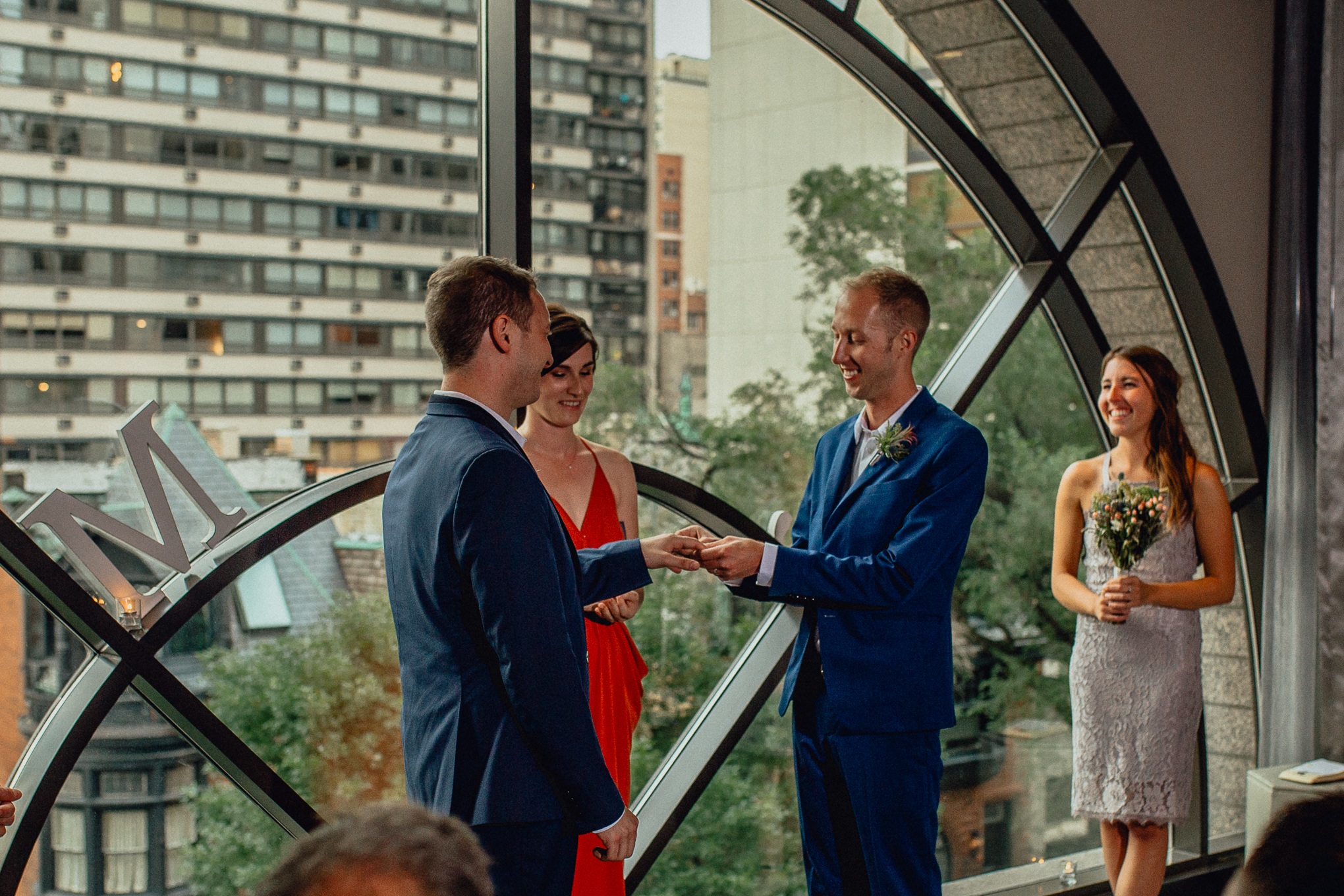 thompson-chicago-hotel-wedding-ceremony-exchanging-rings.jpg