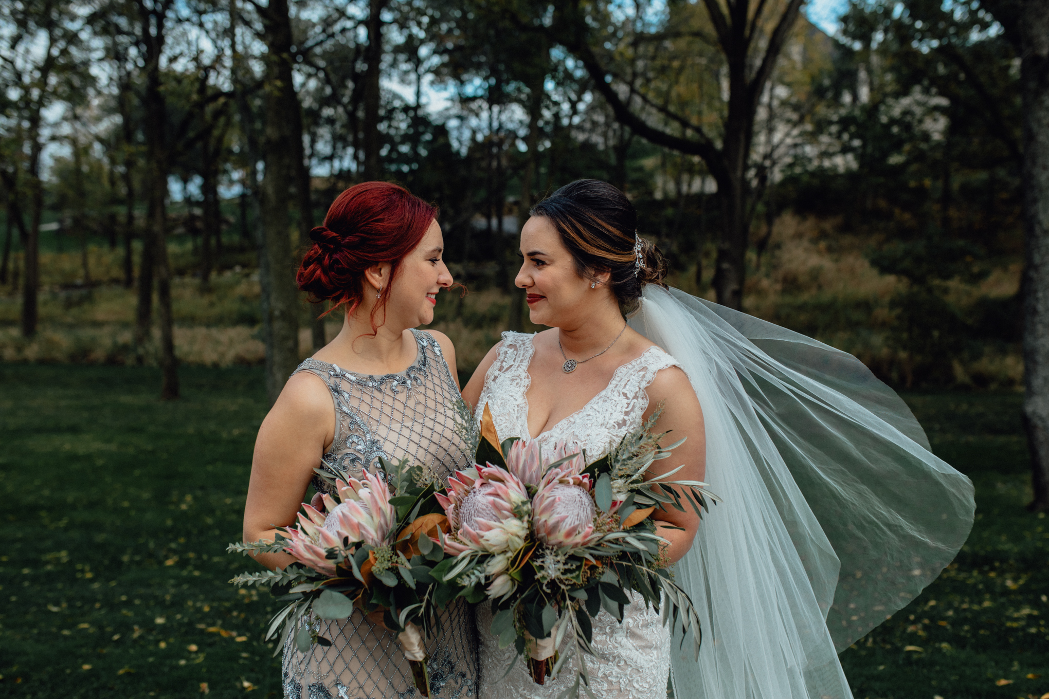 bridesmaid-and bride-in-grass.jpg