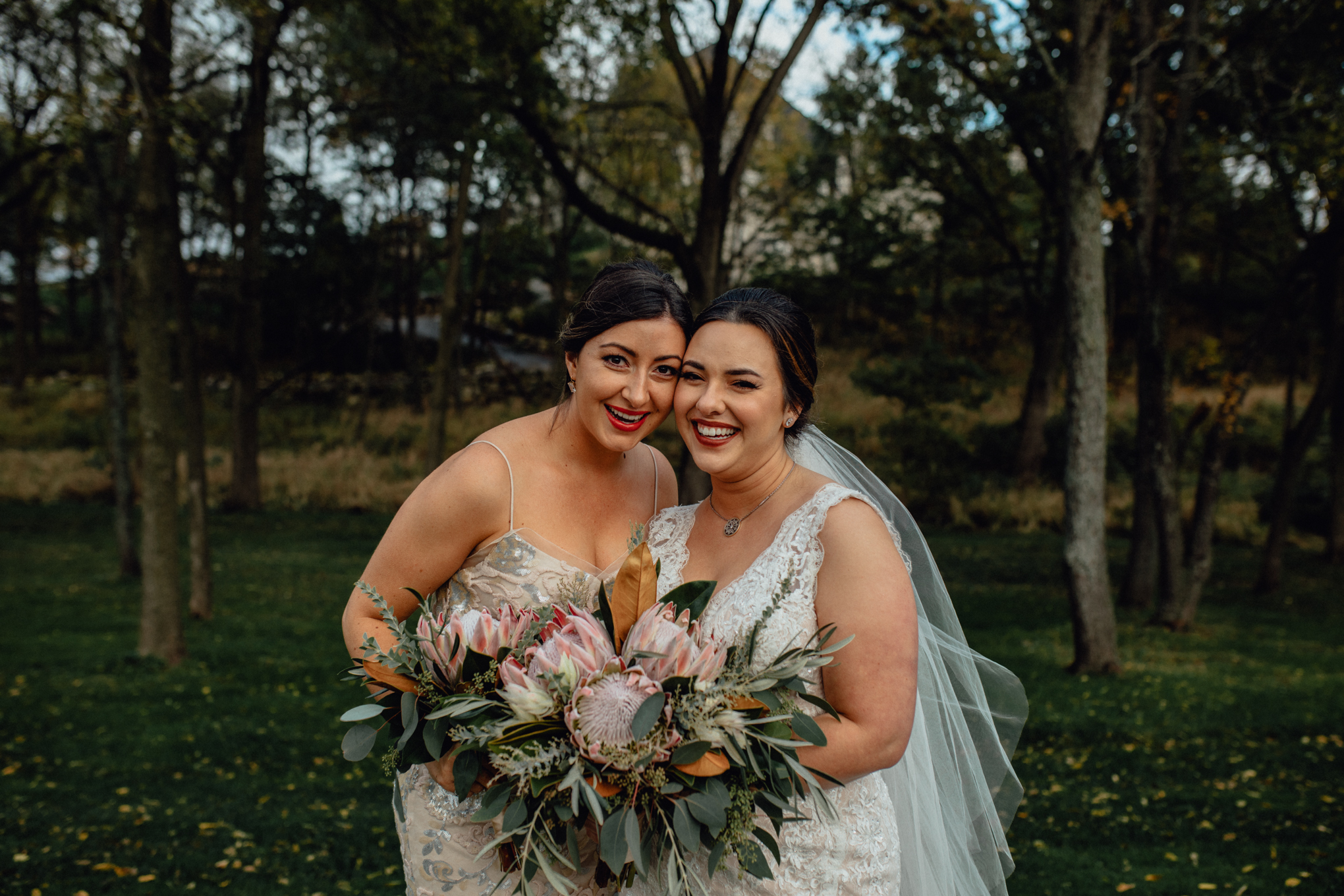 bridesmaid-smiling-with-bride-in-grass.jpg