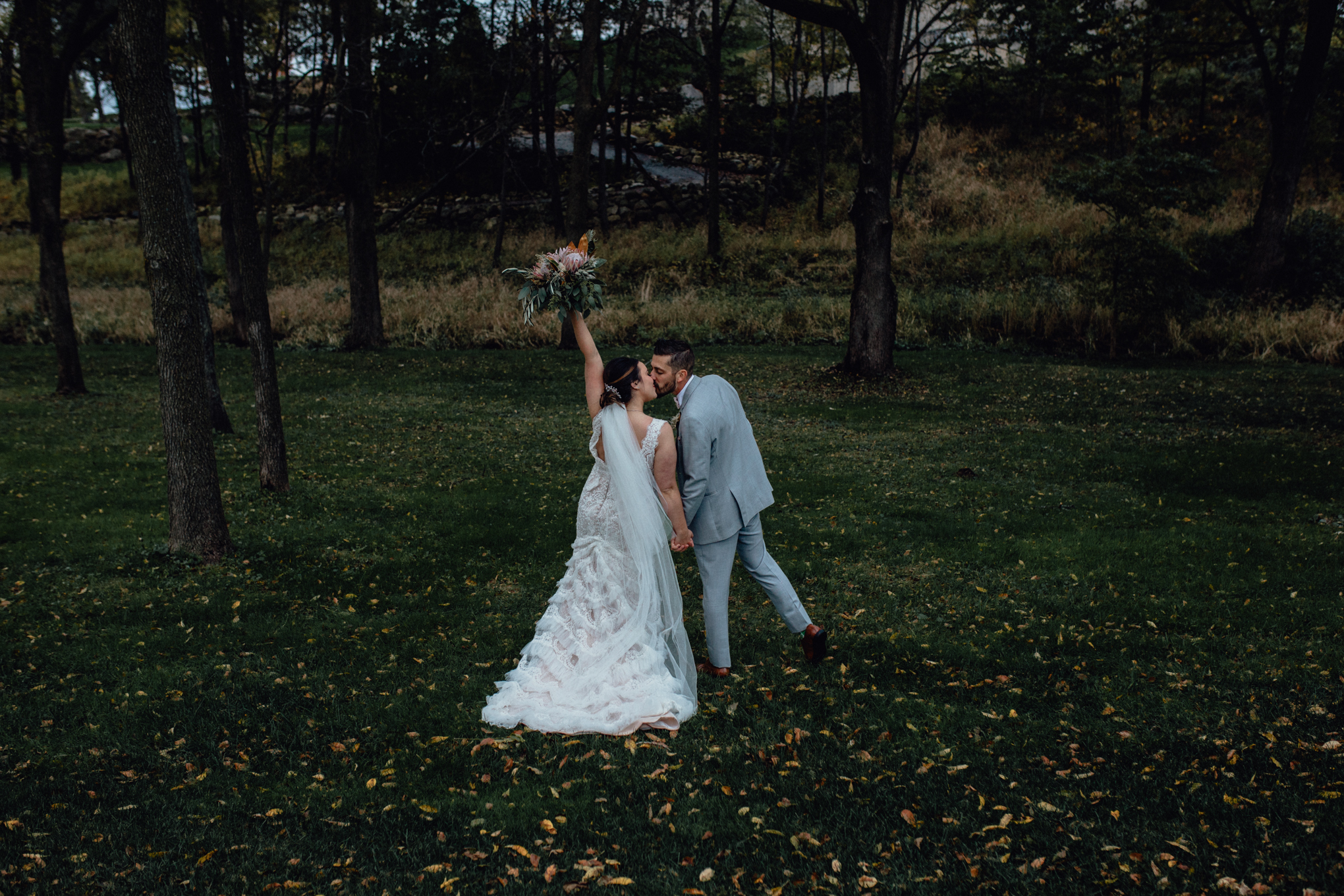 bride-and-groom-cheer-in-grass.jpg