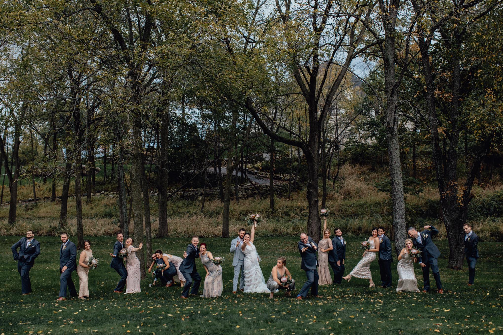 bridesmaids-and-groomsmen-posing-in-grass.jpg