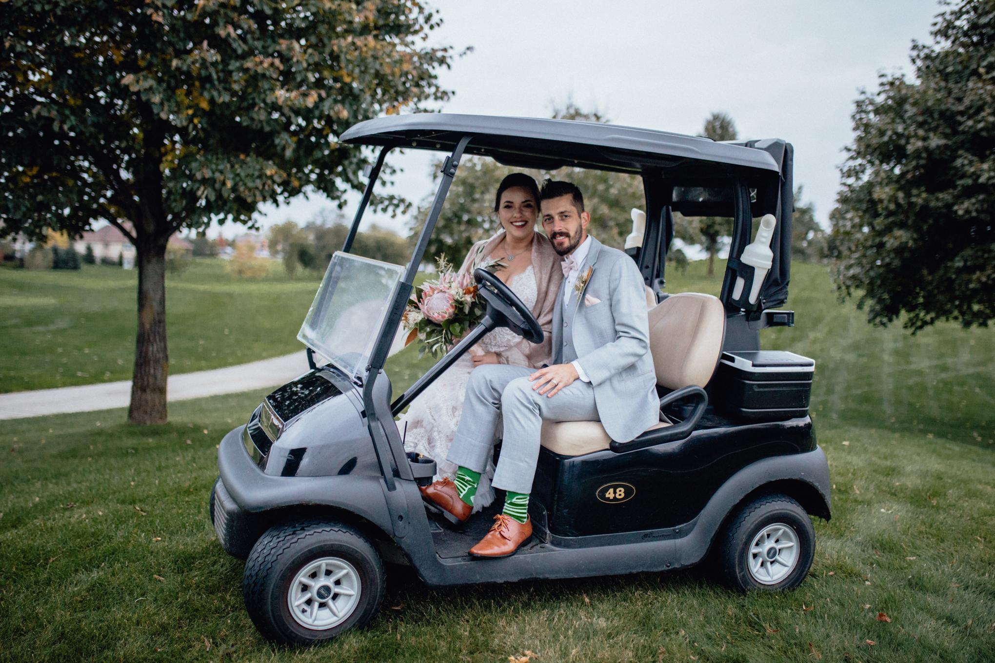 bride-and-groom-on-golf-cart-at-brandybrook.jpg