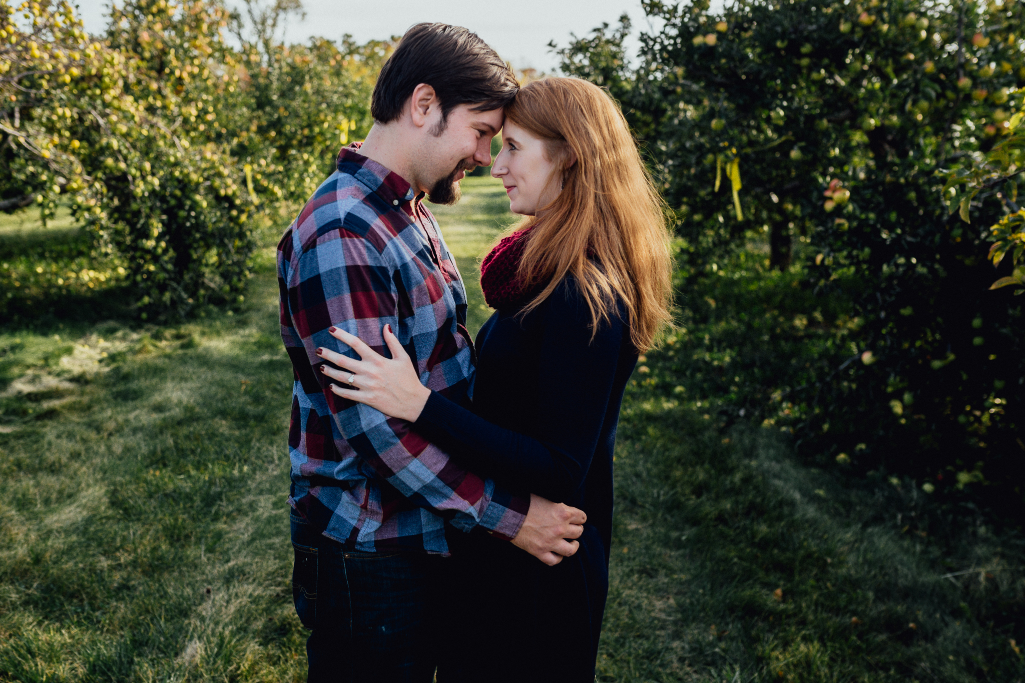 ENGAGEd-couple-kissing-in-apple-orchard.jpg