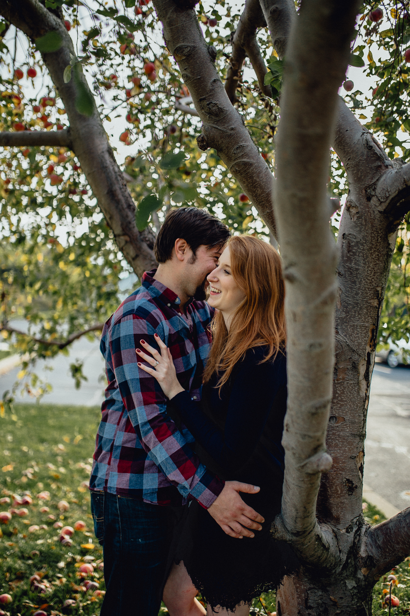 ENGAGEd-couple-posing-in-apple-orchard.jpg