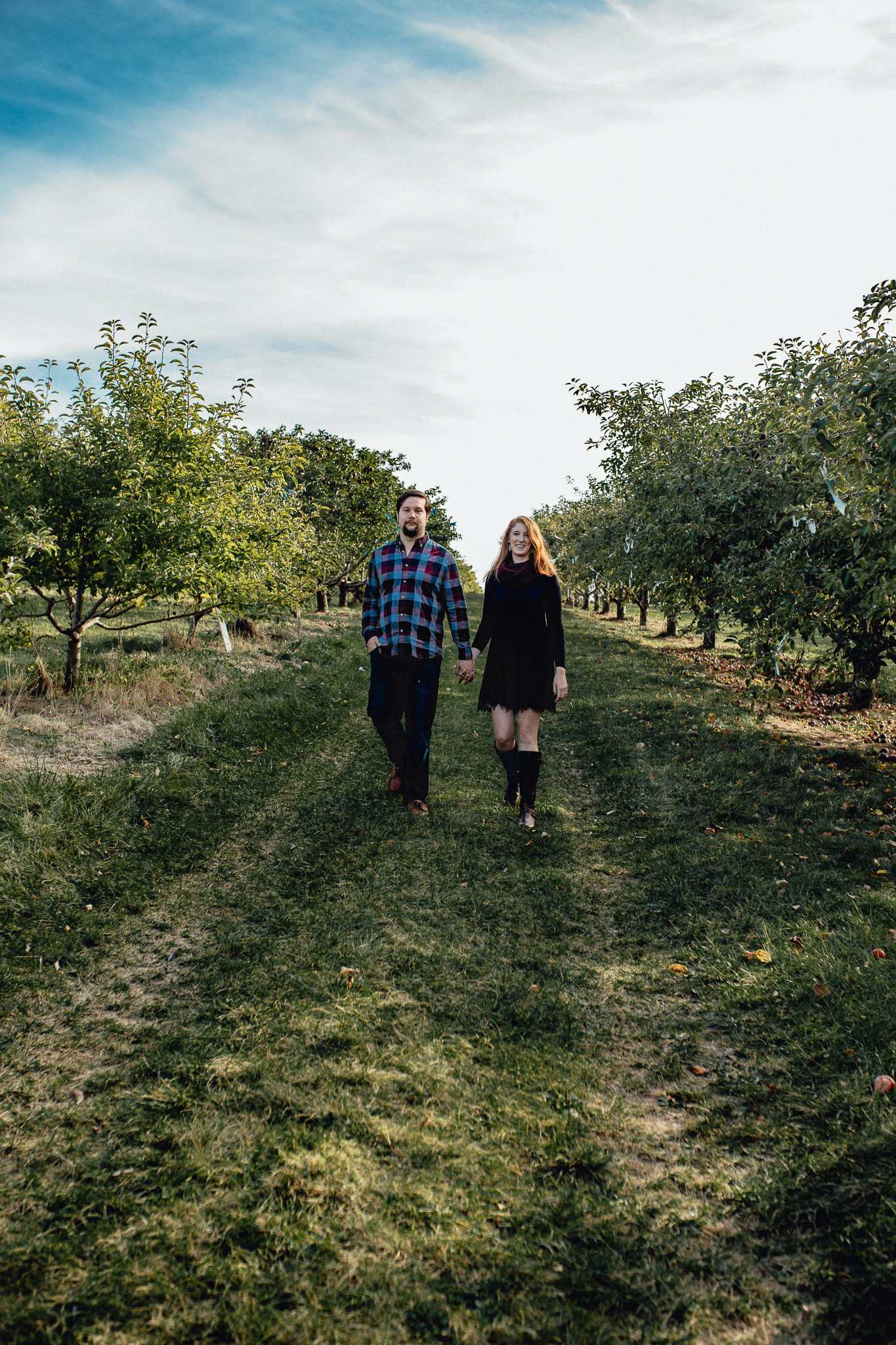 ENGAGEd-couple-in-apple-orchard.jpg
