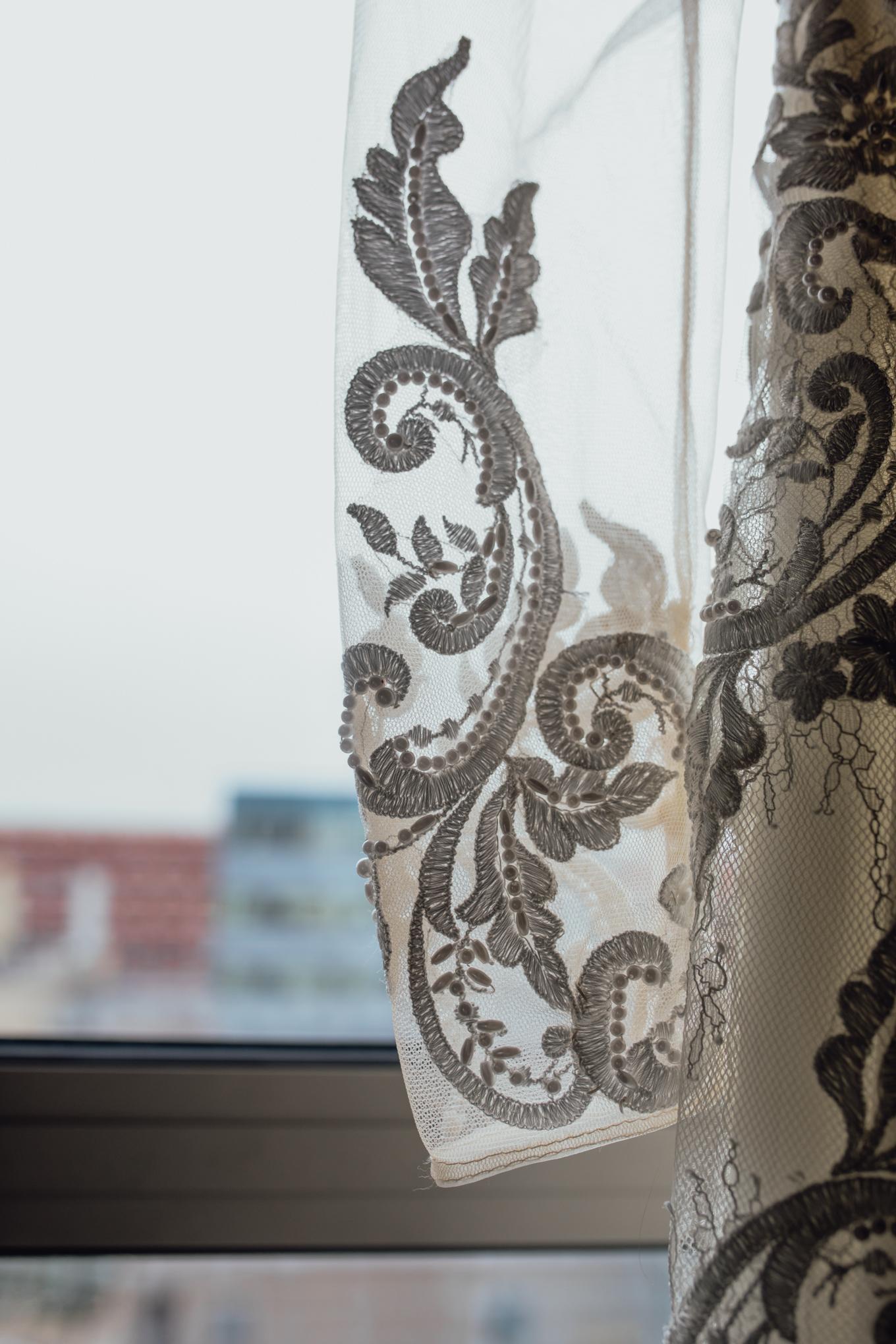 brides-wedding-dress-hanging-in-window.jpg