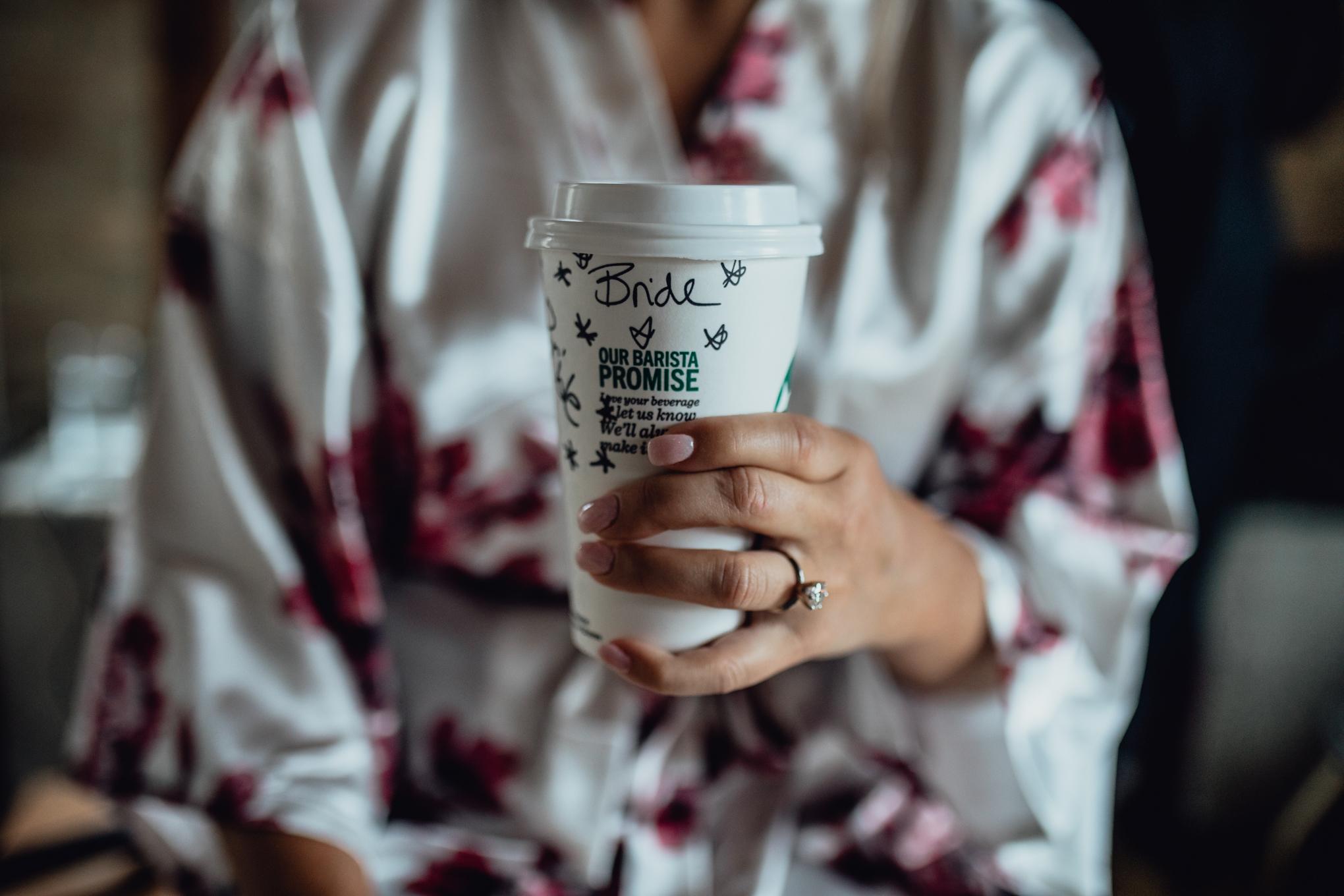 bride-holding-starbucks-coffee-with-ring.jpg