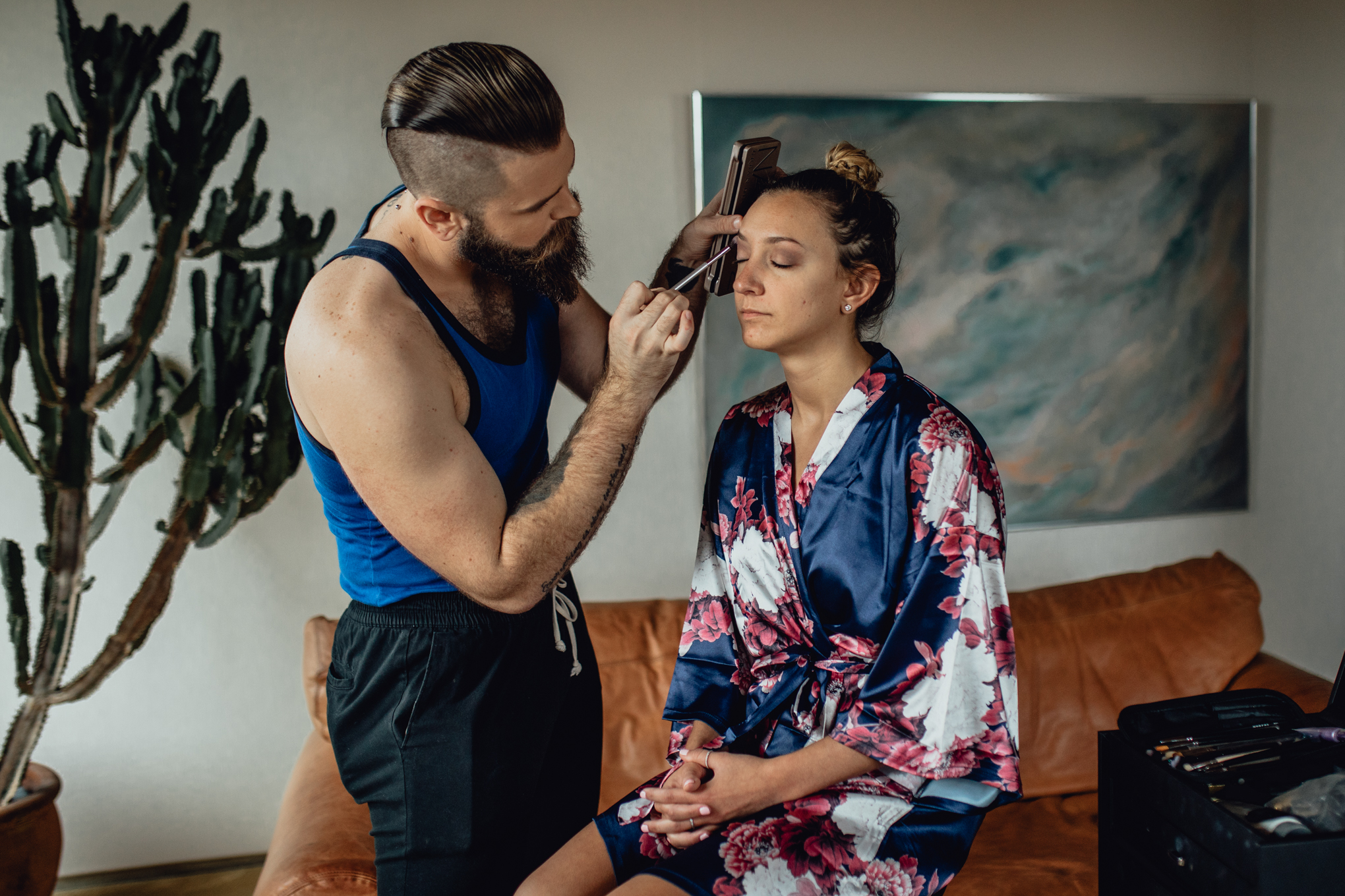 Kyle-Bakalars-applying-bridesmaids-wedding-makeup.jpg
