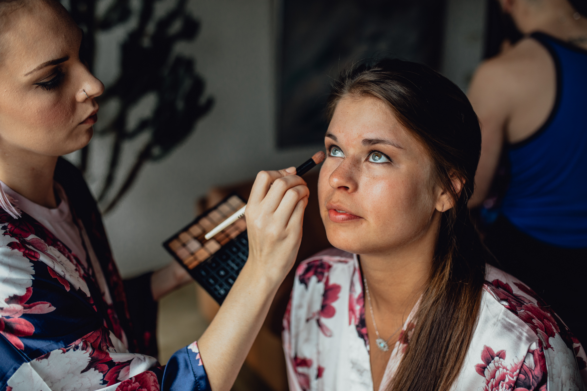 maddy-hacker-applying-bridesmaids-wedding-makeup.jpg