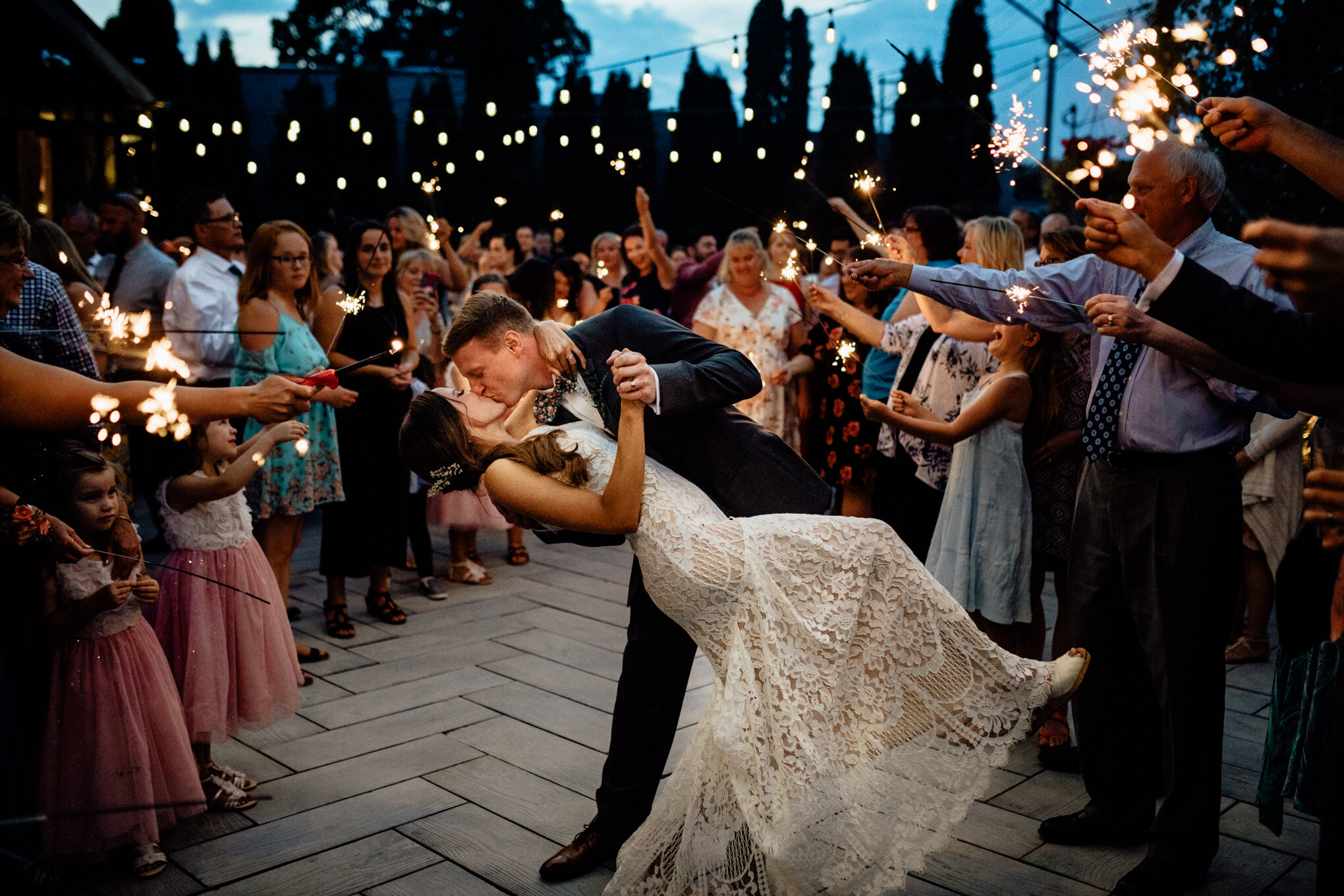 bride and groom dipping on patio at birch wauwatosa with sparklers