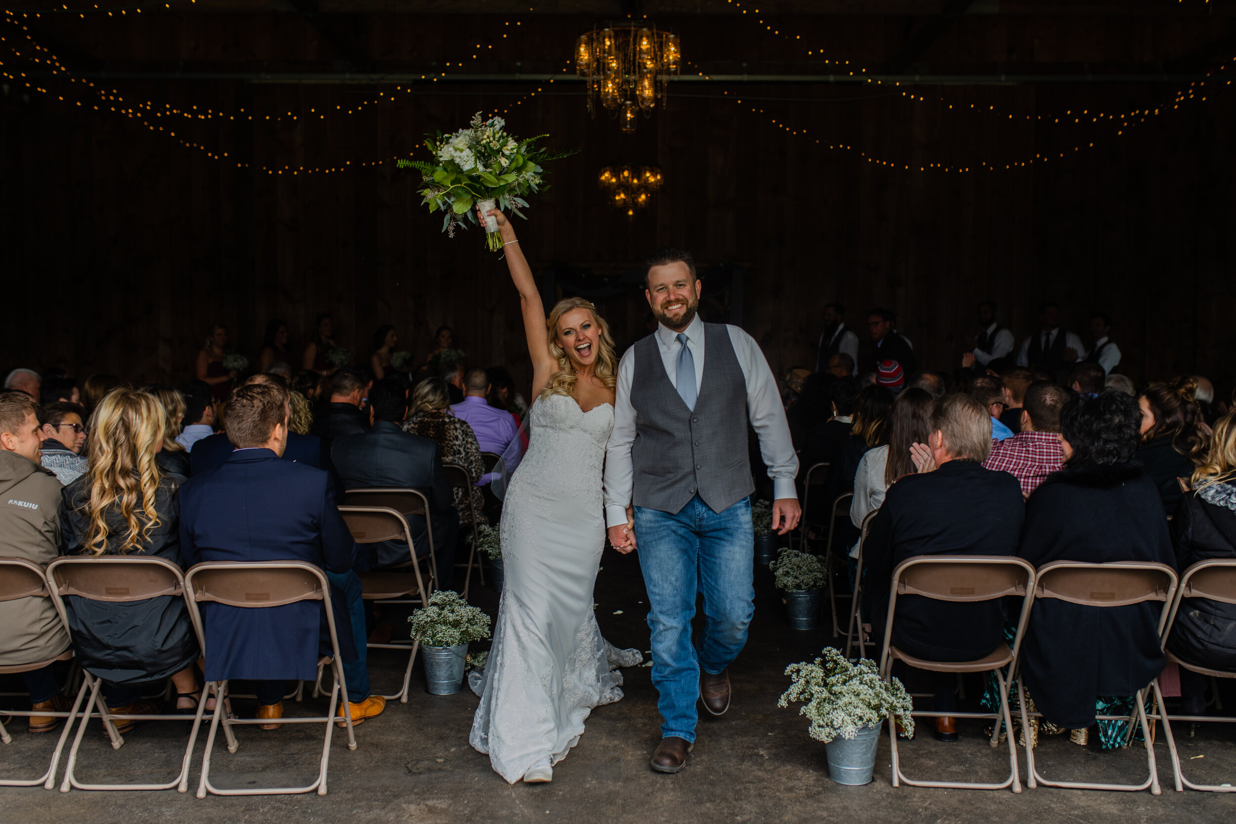 bride-and-groom-just-married-exiting-ceremony-out-of-barn-at-kettle-moraine-ranch.jpg