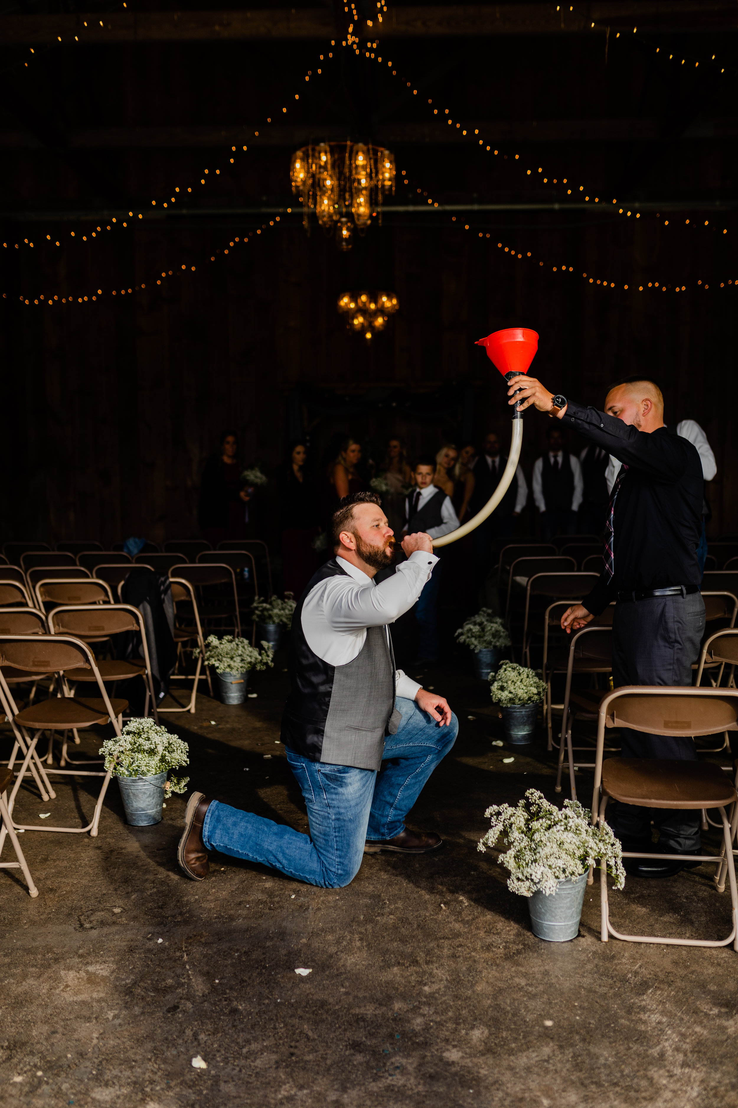 groom-doing-a-beer-bong-after-ceremony.jpg