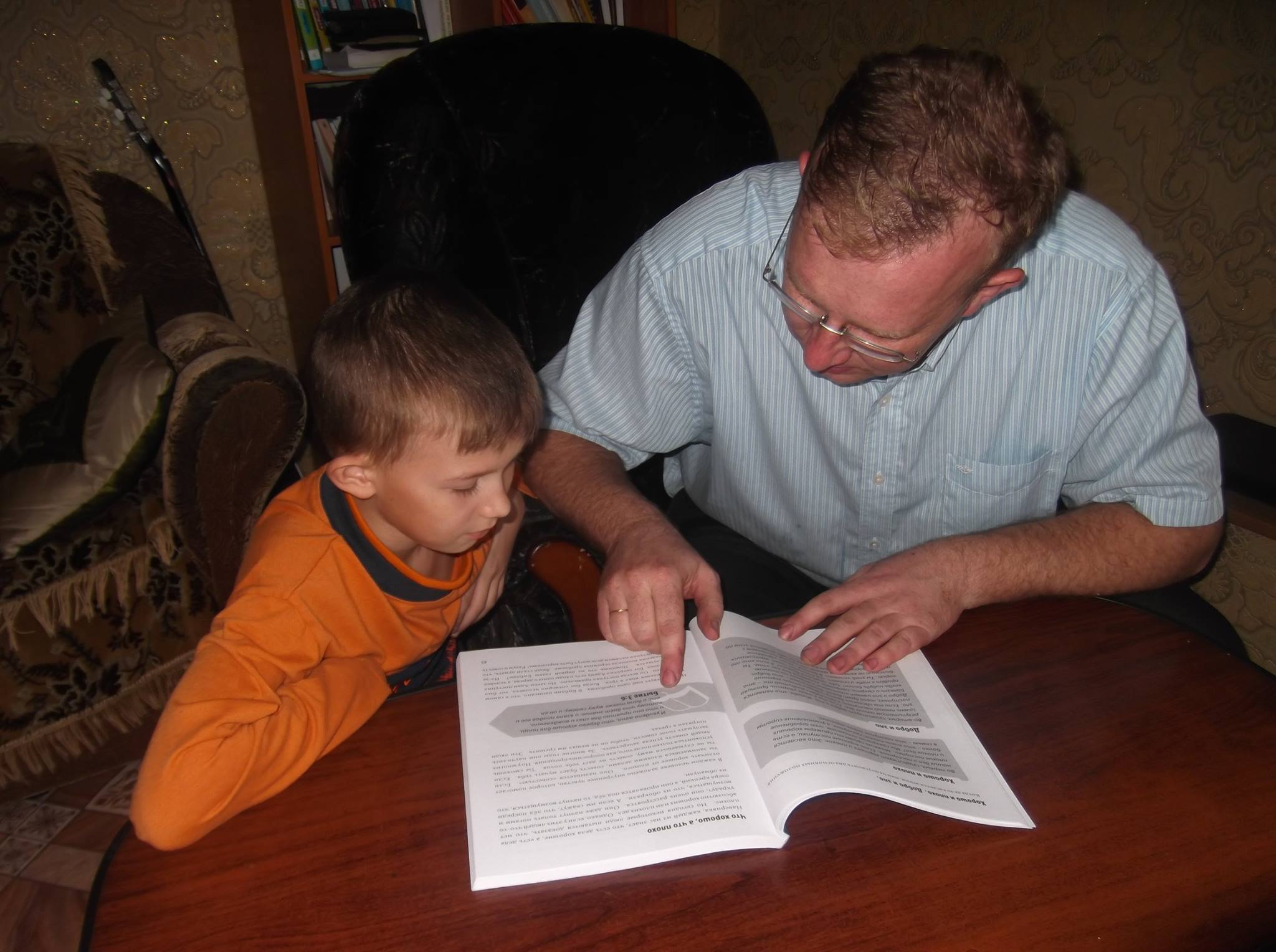 Jhenya helps his son Slava to gain an understanding of a new subject.