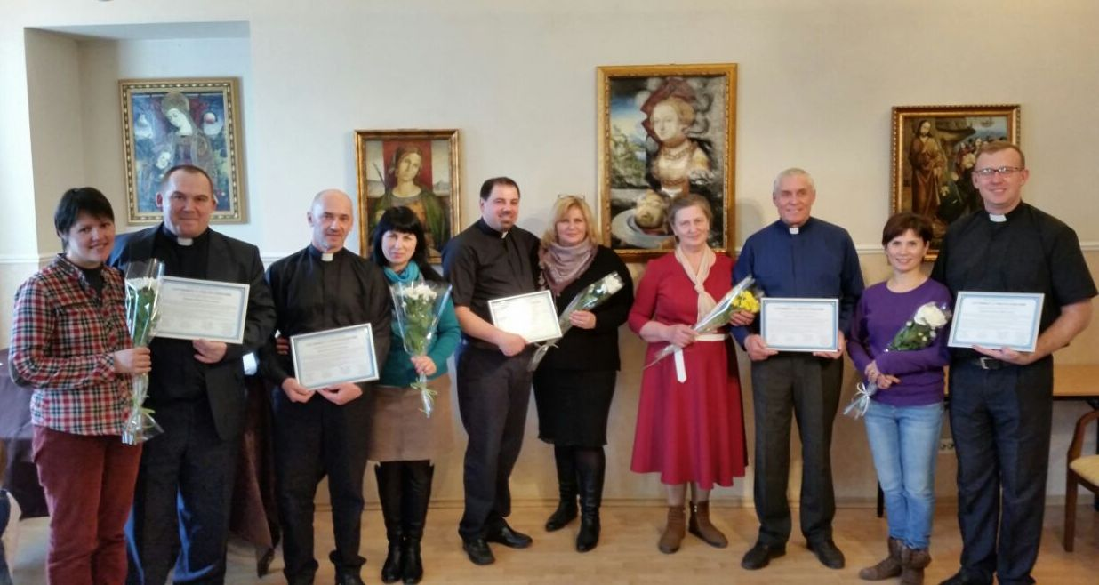 The pillars of the new presbytery with wives