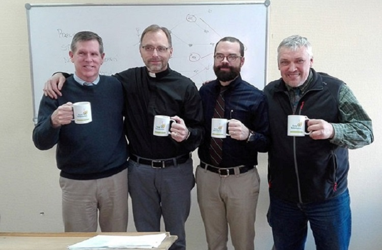 Visiting professors and Oleg Volkov with SRS mugs.