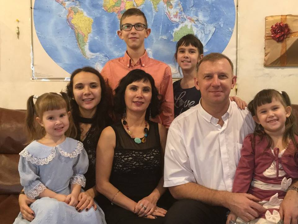 - Evgeniy with his family: wife Saule and children: Adel (19), Slava (13), Vera (10), Margarete (5), and Lidiya (4).