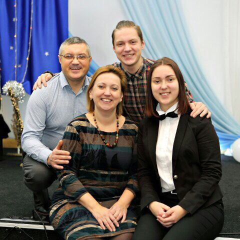 Andrey with his wife Tatyana, and son Egor and daughter Christina.jpg