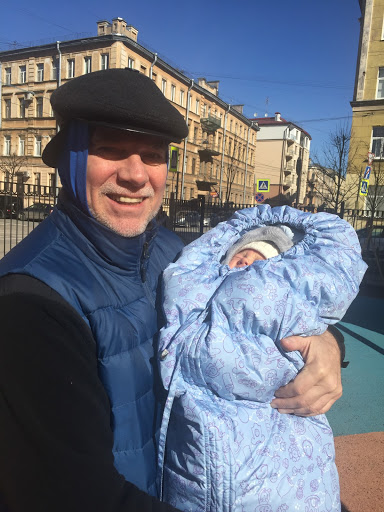 Here I am April 2 in St. Petersburg, Russia, near our home, with our 3rd Russian grandbaby that is a Russian citizen, Vasili. He loves the rare sunshine up here 500 miles south of the Arctic Circle.