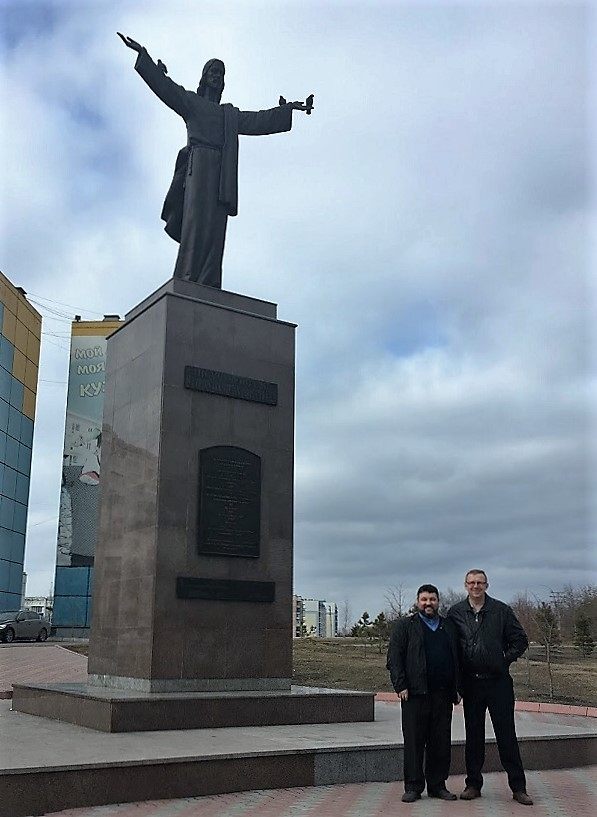 HopeRussia pastors Andrea Skryabin, left, and Evgeni Kruzhkov, in front of one of Russia's only statues of Jesus, downtown, Prokopyevsk, Siberia.
