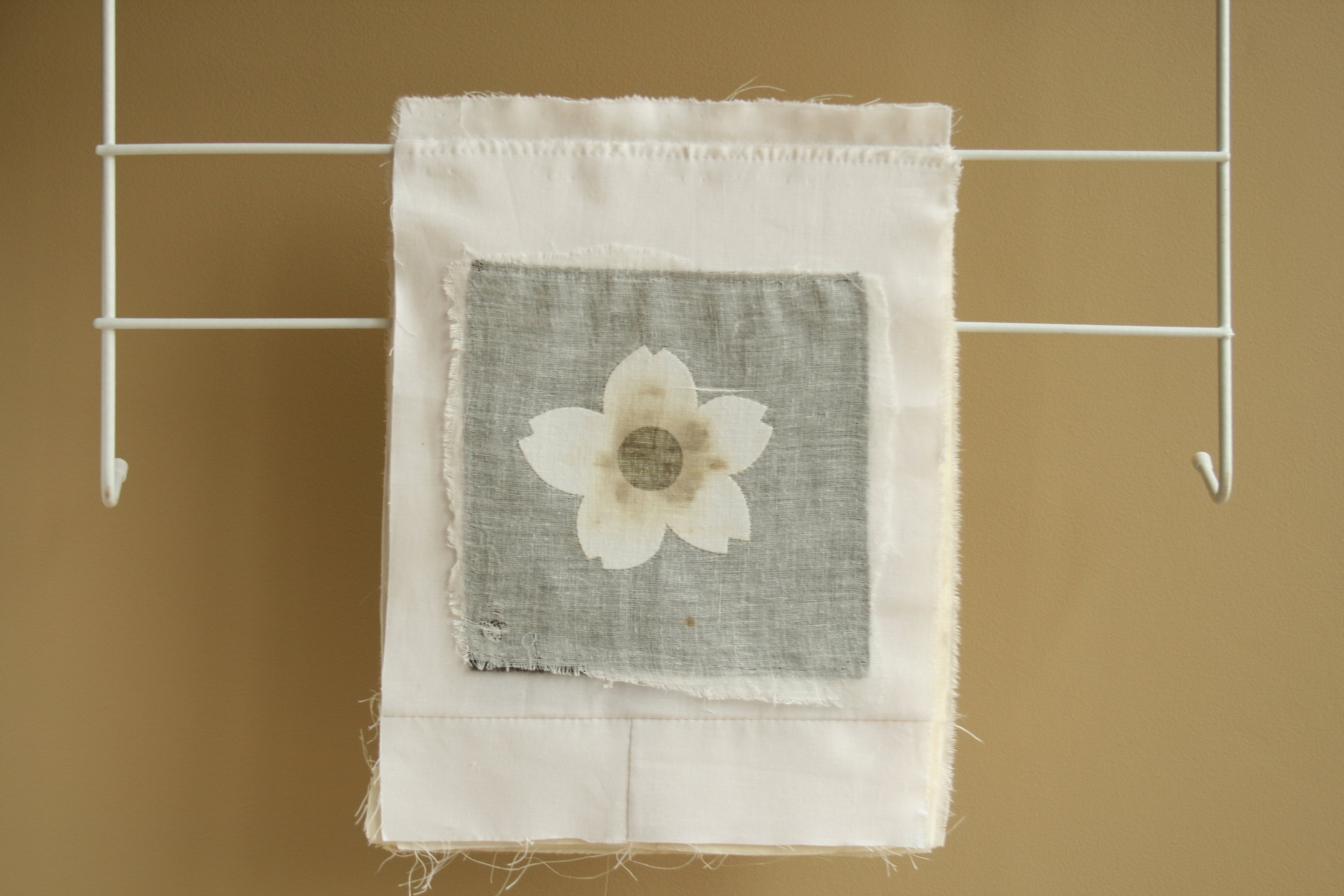 Jane Hellings (2010) Hymen Flowers. Fabric, menstrual blood, clothes airer..JPG